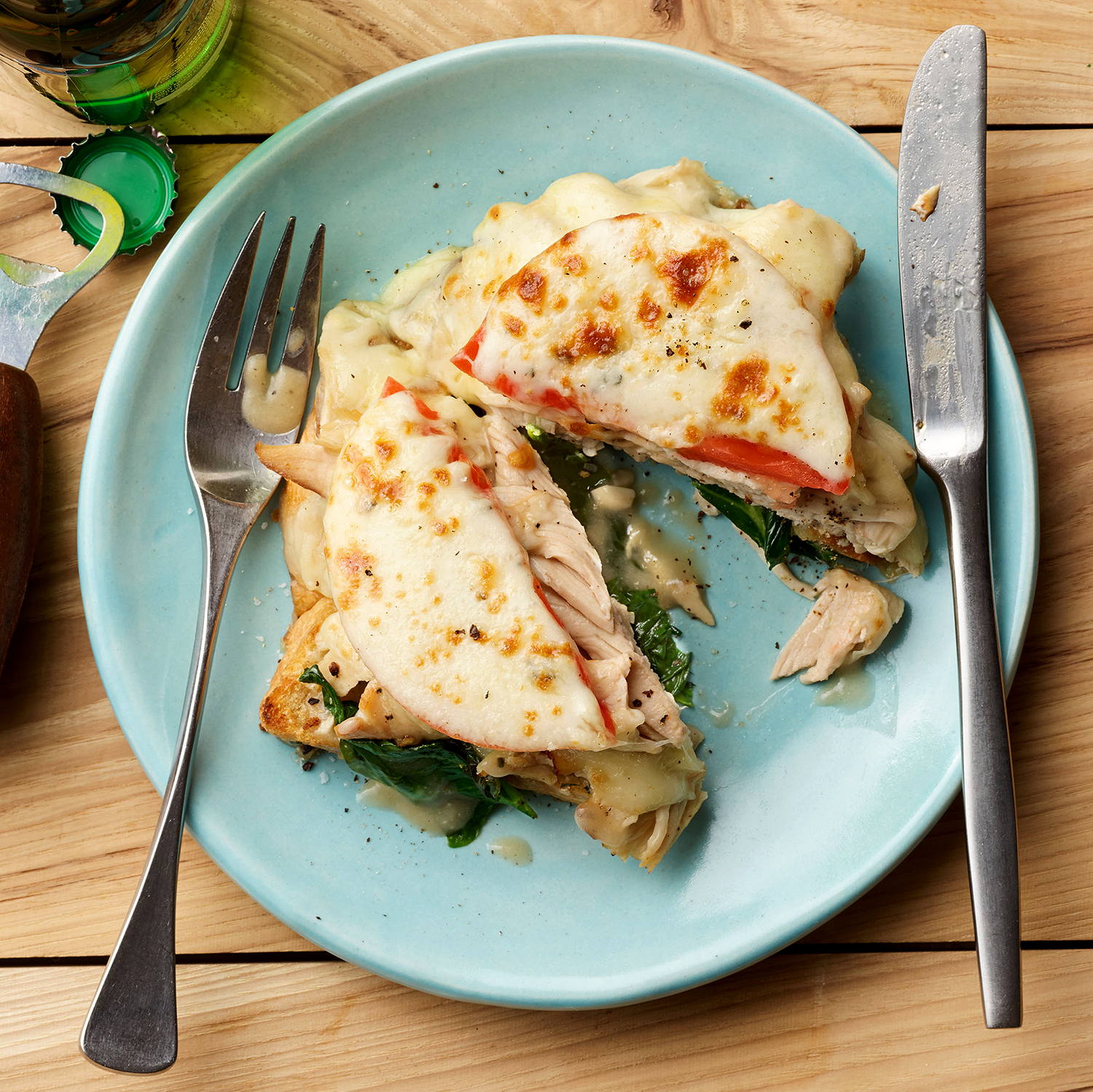 Garlic Toasts with Wilted Spinach, Turkey, Gravy, Tomato & Provolone