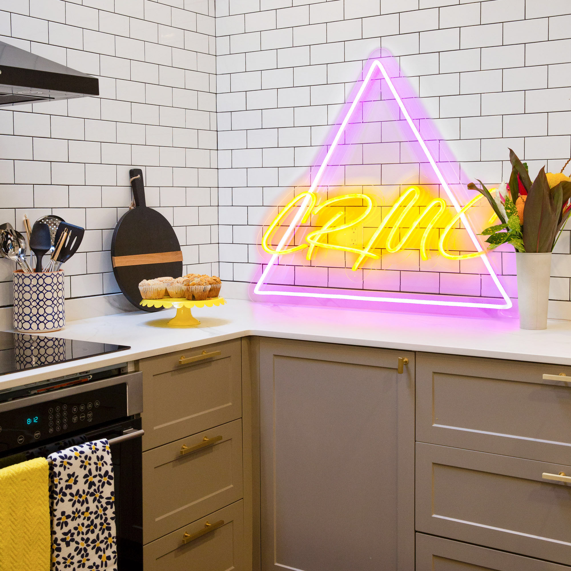 kitchen with triangle neon sign