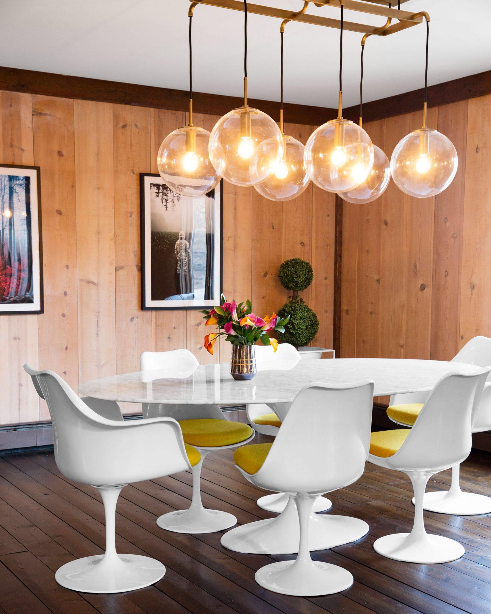 modern dining room globe lights yellow chairs