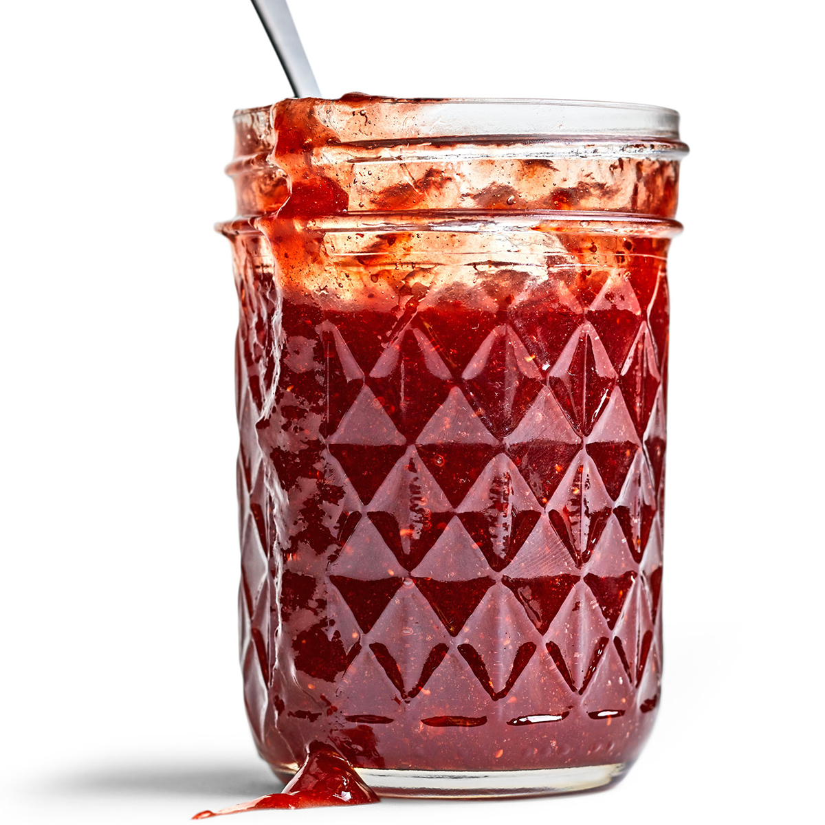red berry jam in glass jar