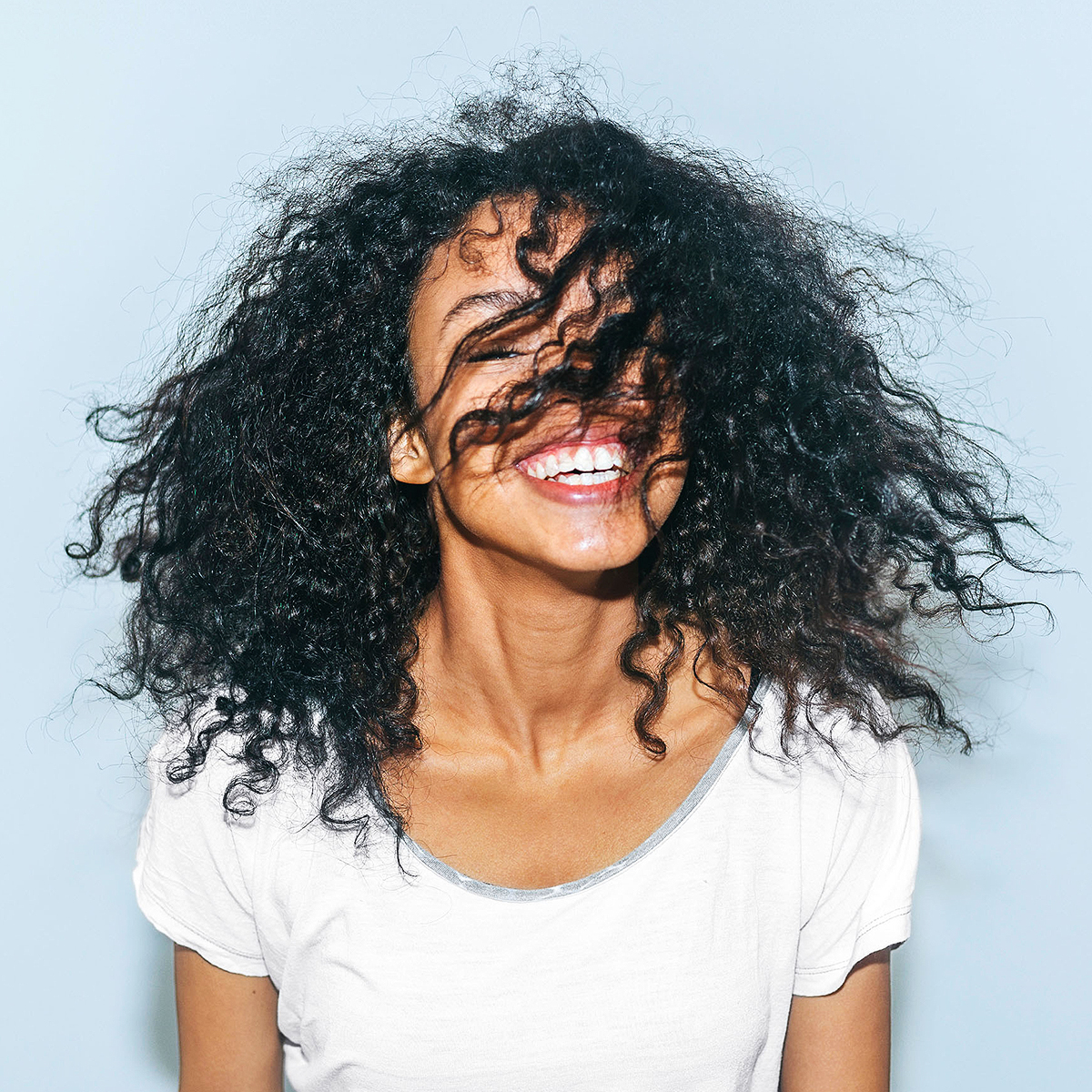 woman-shaking-hair-smiling-508e7abf
