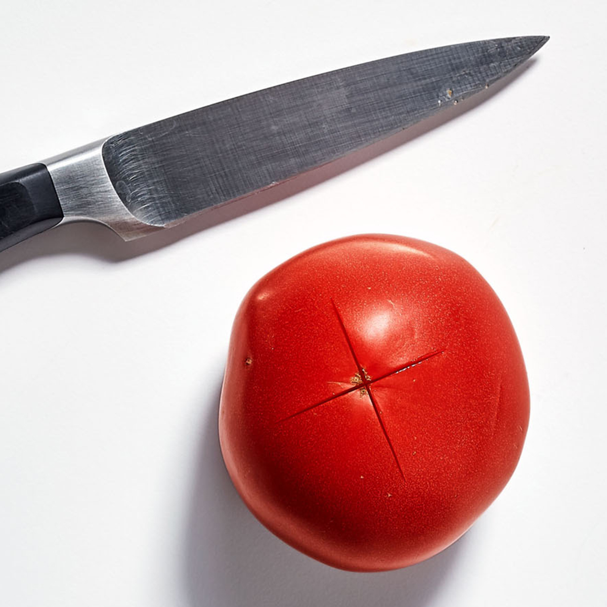 tomato with knife