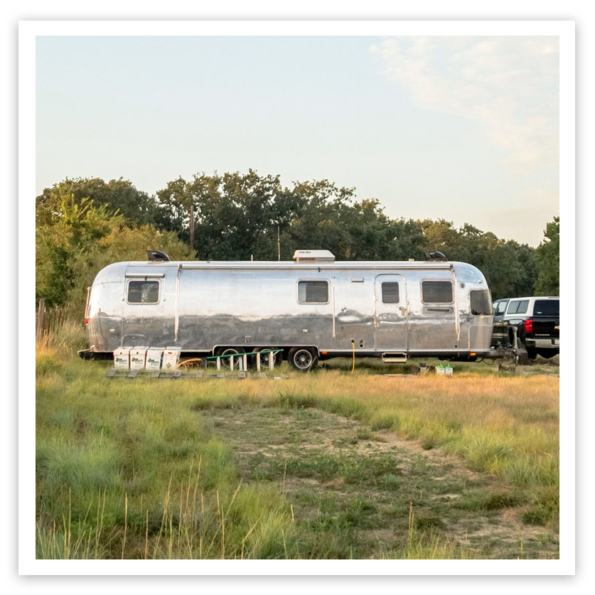 parked silver airstream excella trailer