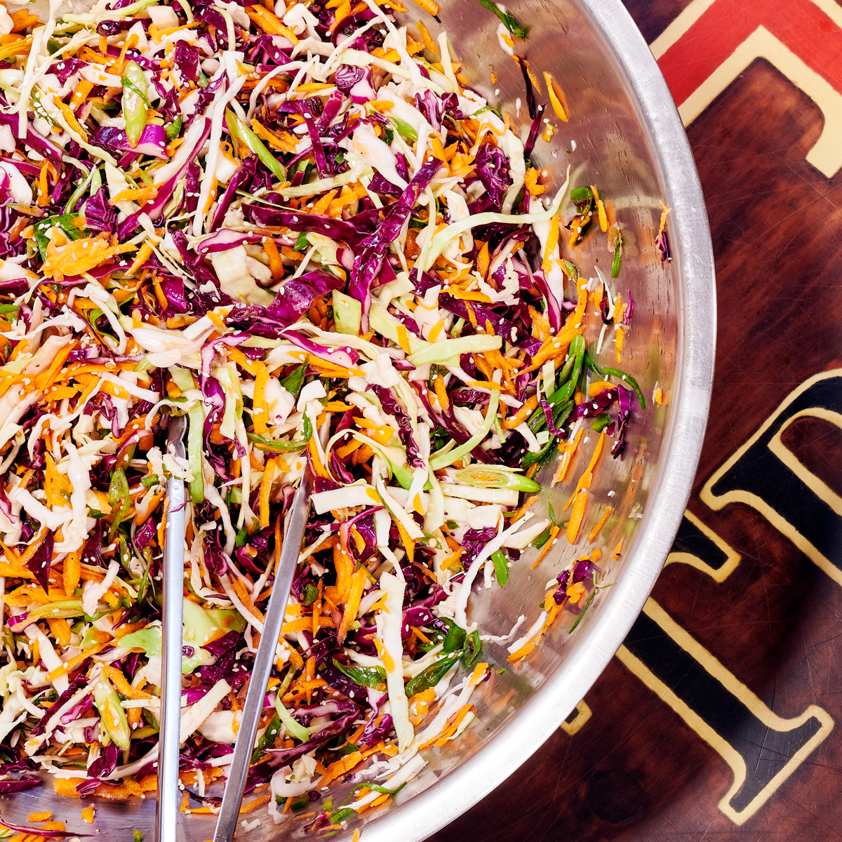 mayo-less coleslaw in a silver bowl