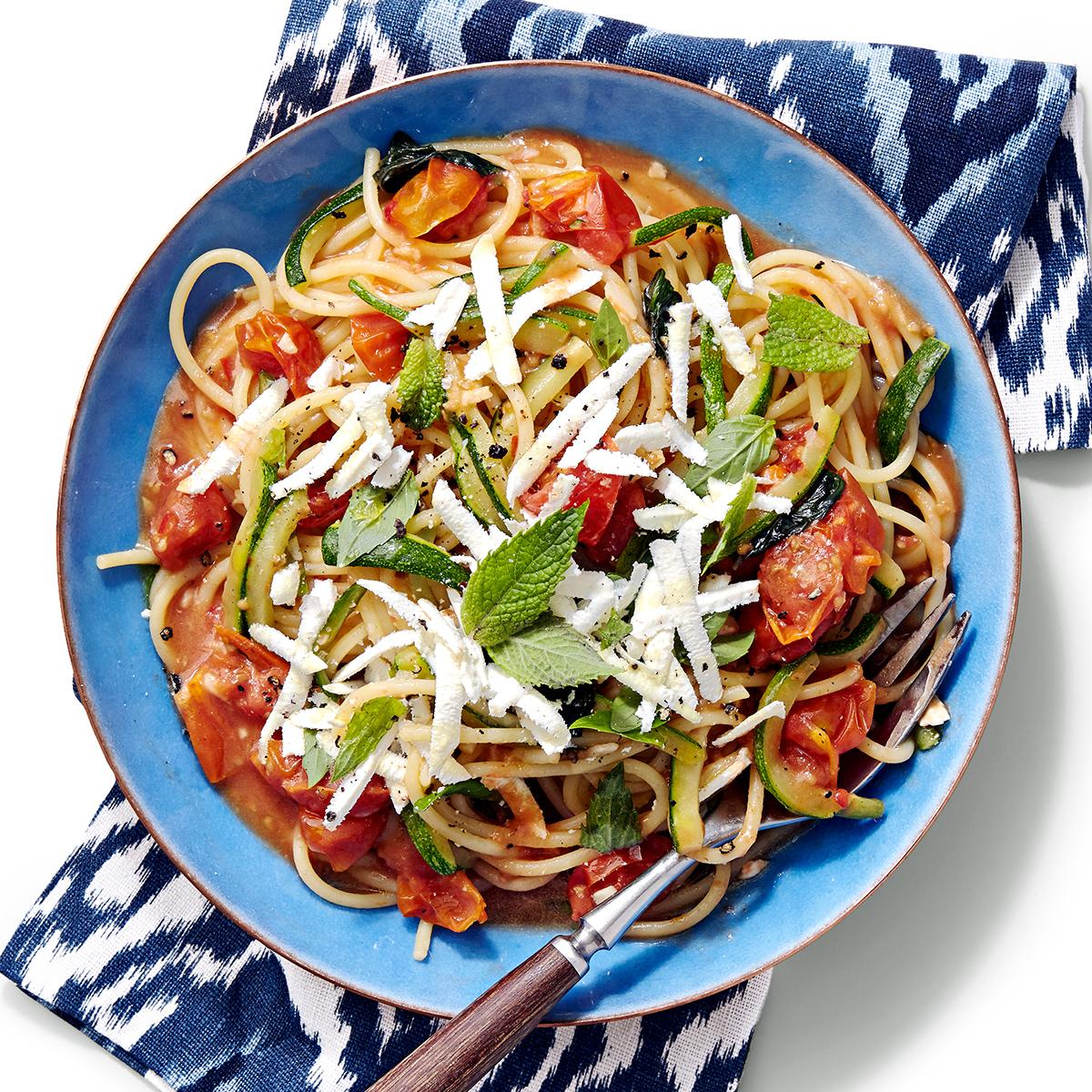 spaghetti with zucchini cherry tomato sauce and ricotta salata