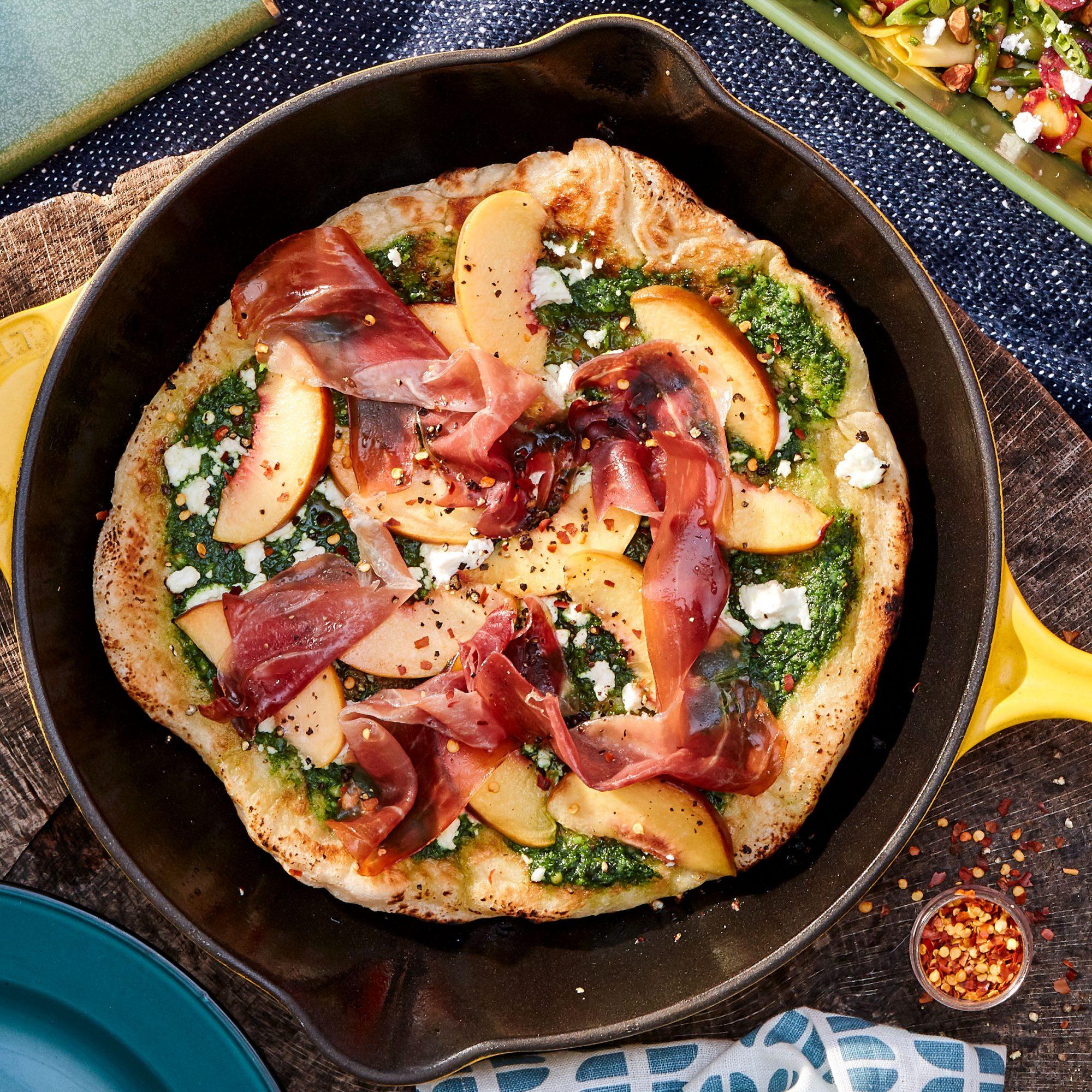 peach prosciutto pesto and goat cheese skillet pizza