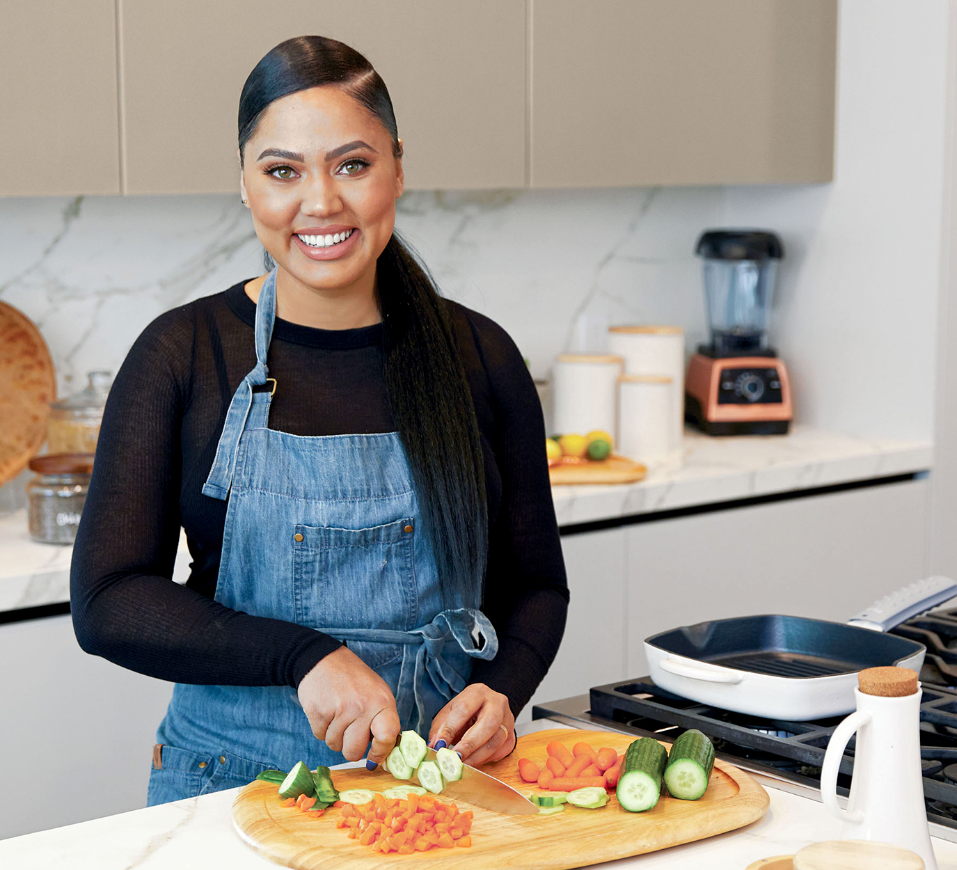 ayesha curry in kitchen cutting vegetables