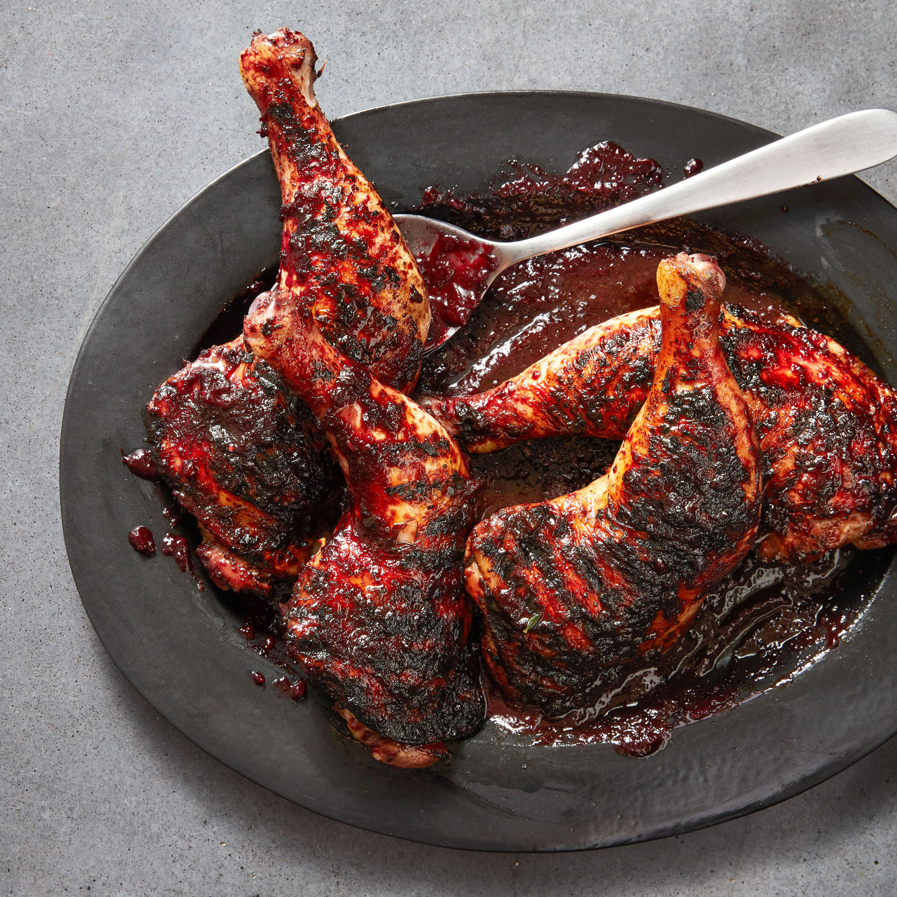 chicken with cherry-fennel barbecue sauce served on gray plate