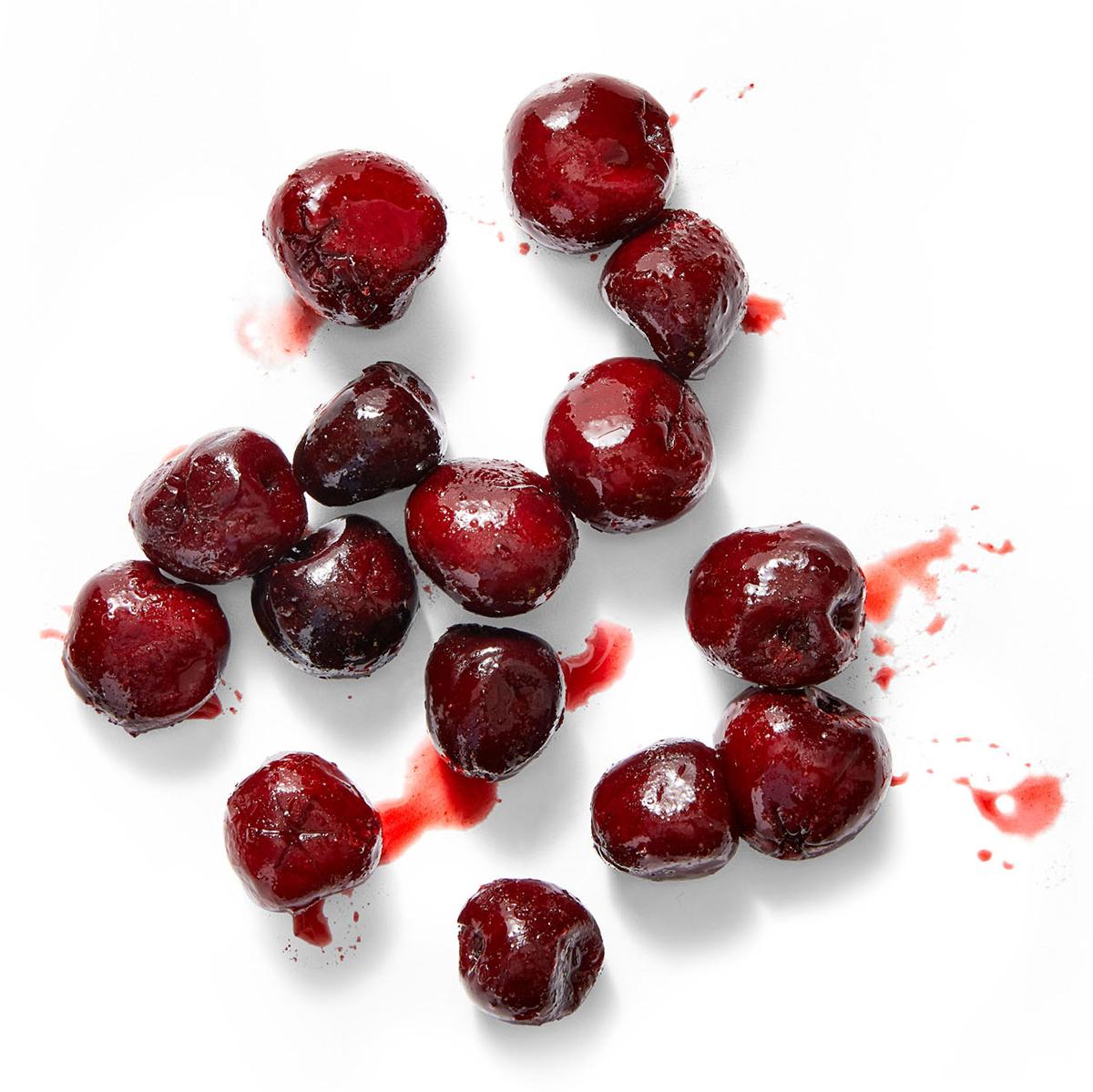 frozen cherries on white surface