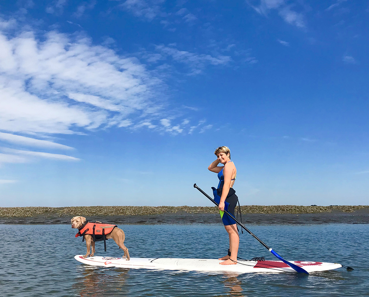 Twinkie and Naomi on a paddle board