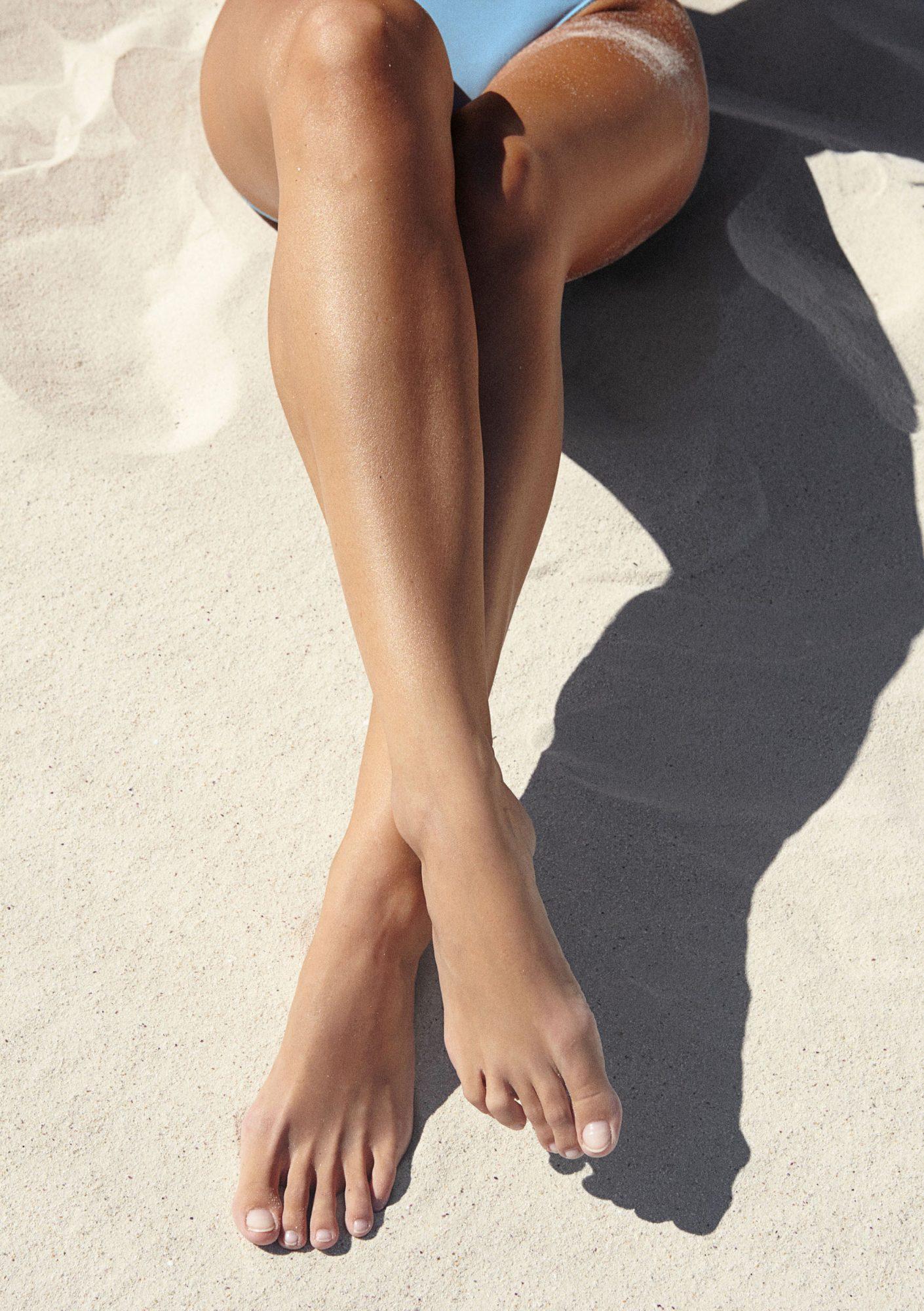 sun bathing legs on beach