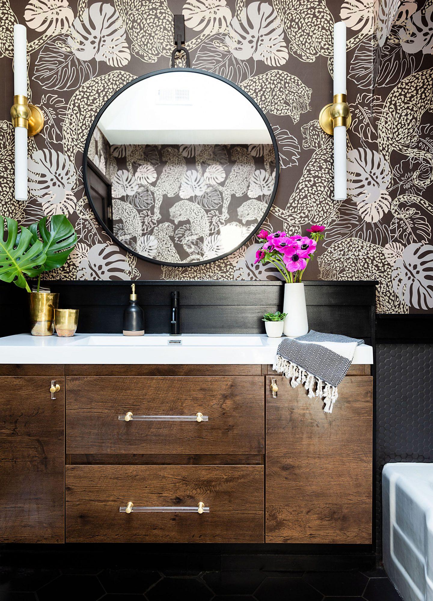bathroom with circular mirror