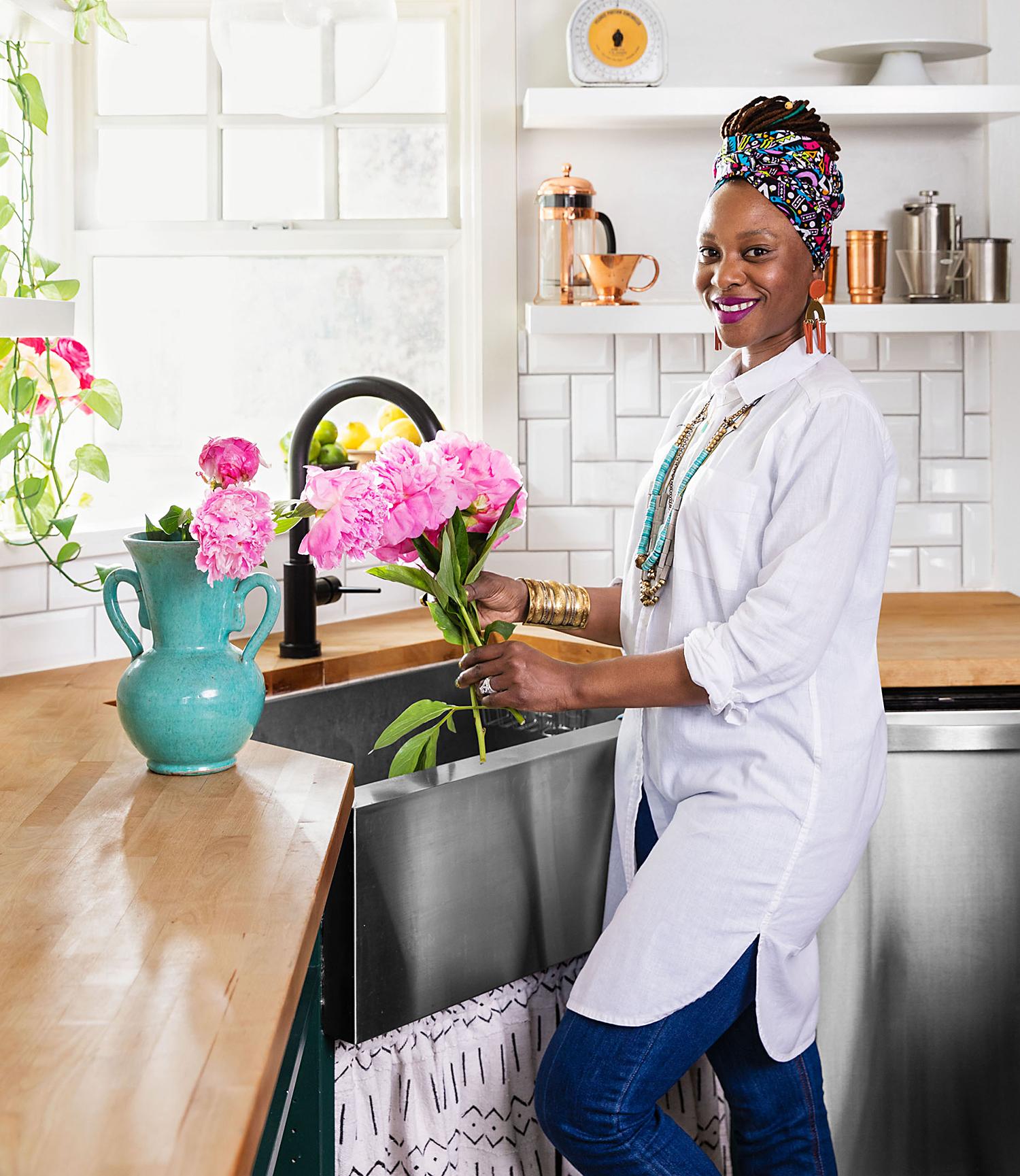 Shavonda Gardner at kitchen sink