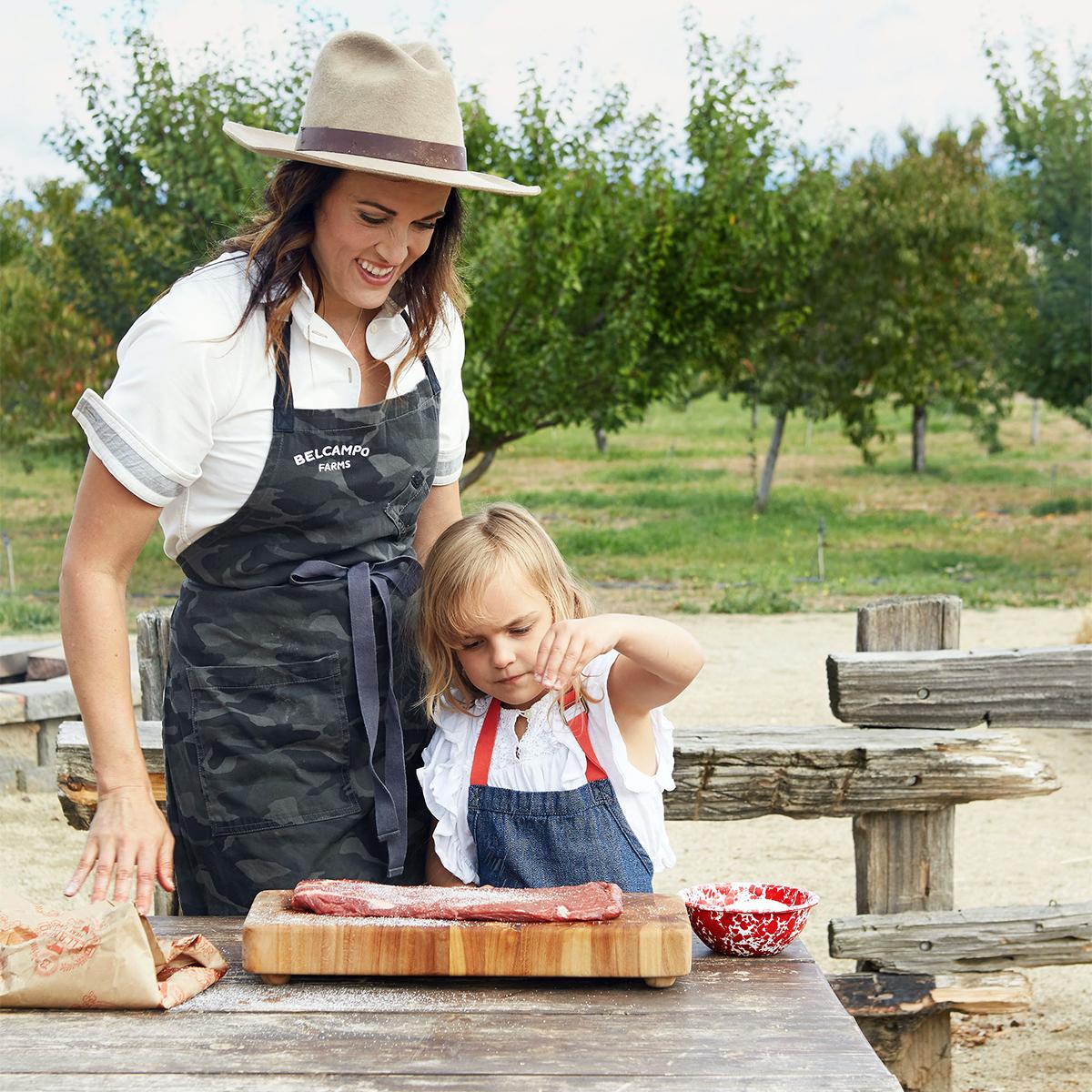 anya fernald and daughter viola salting meat