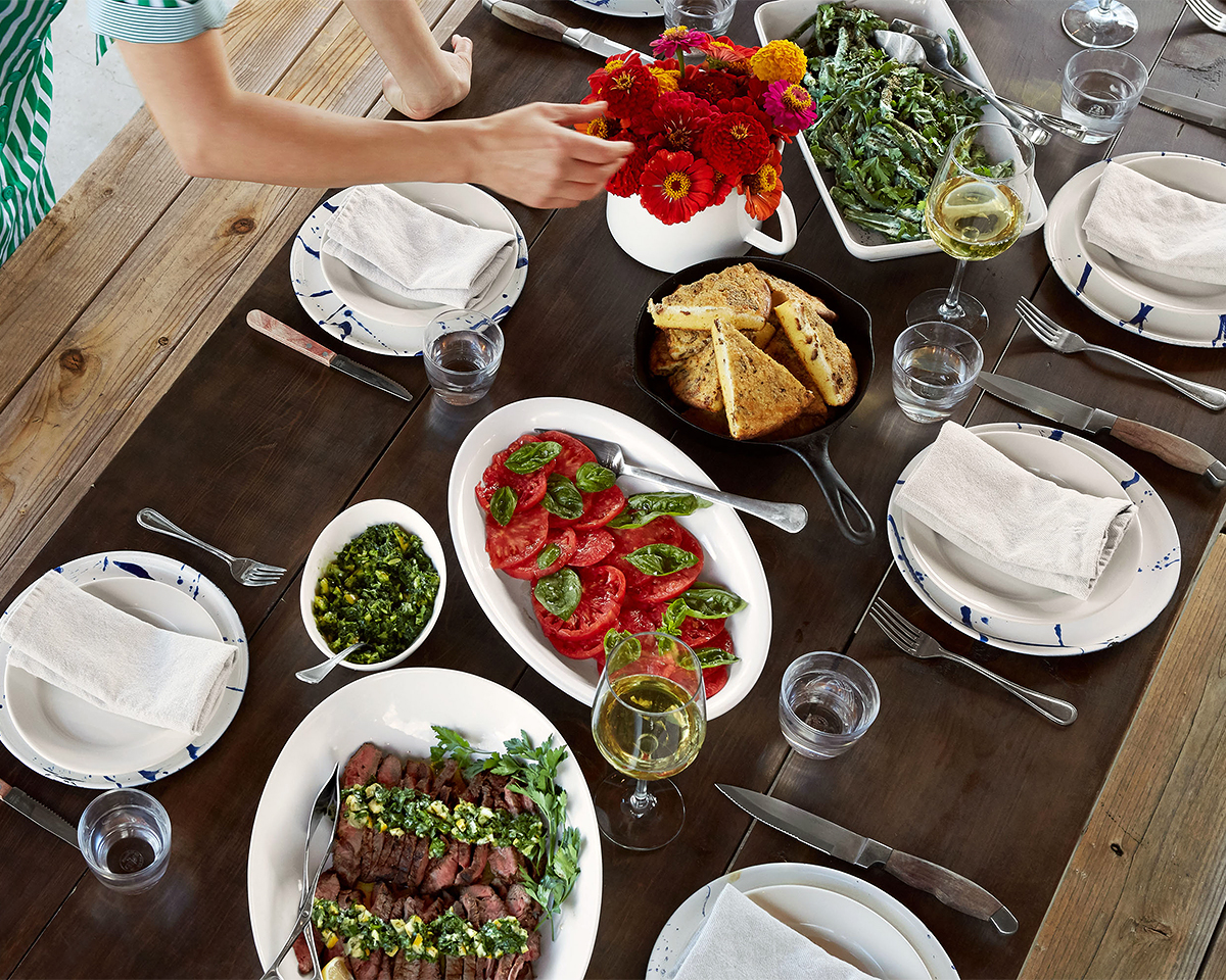 picnic table with recipes in white dishes