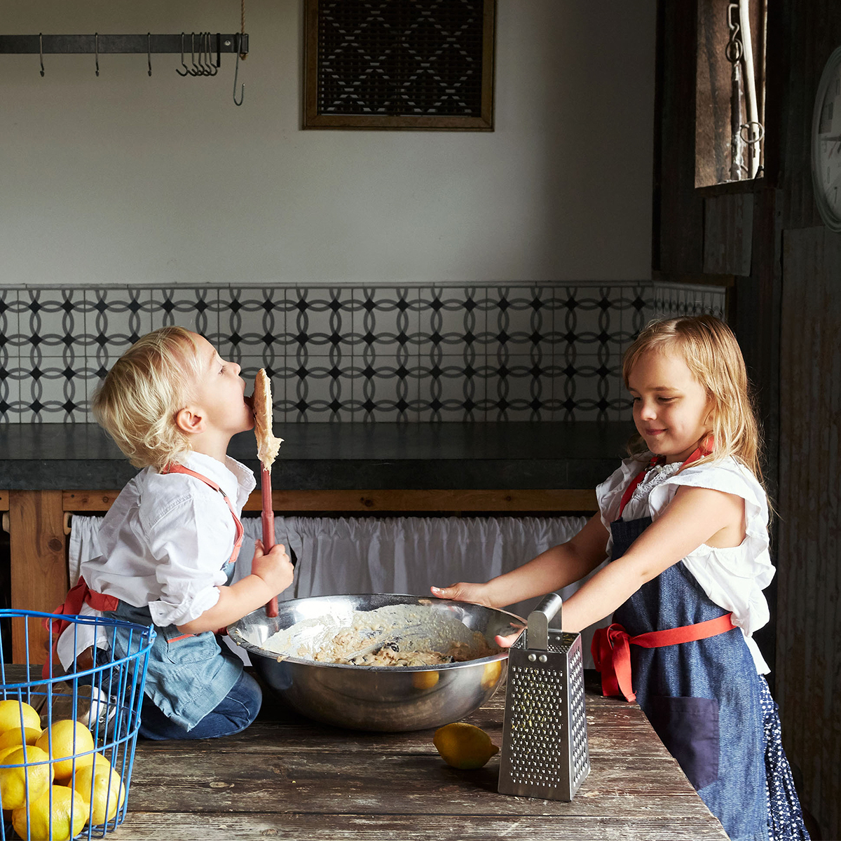 viola and theo helping mix a recipe