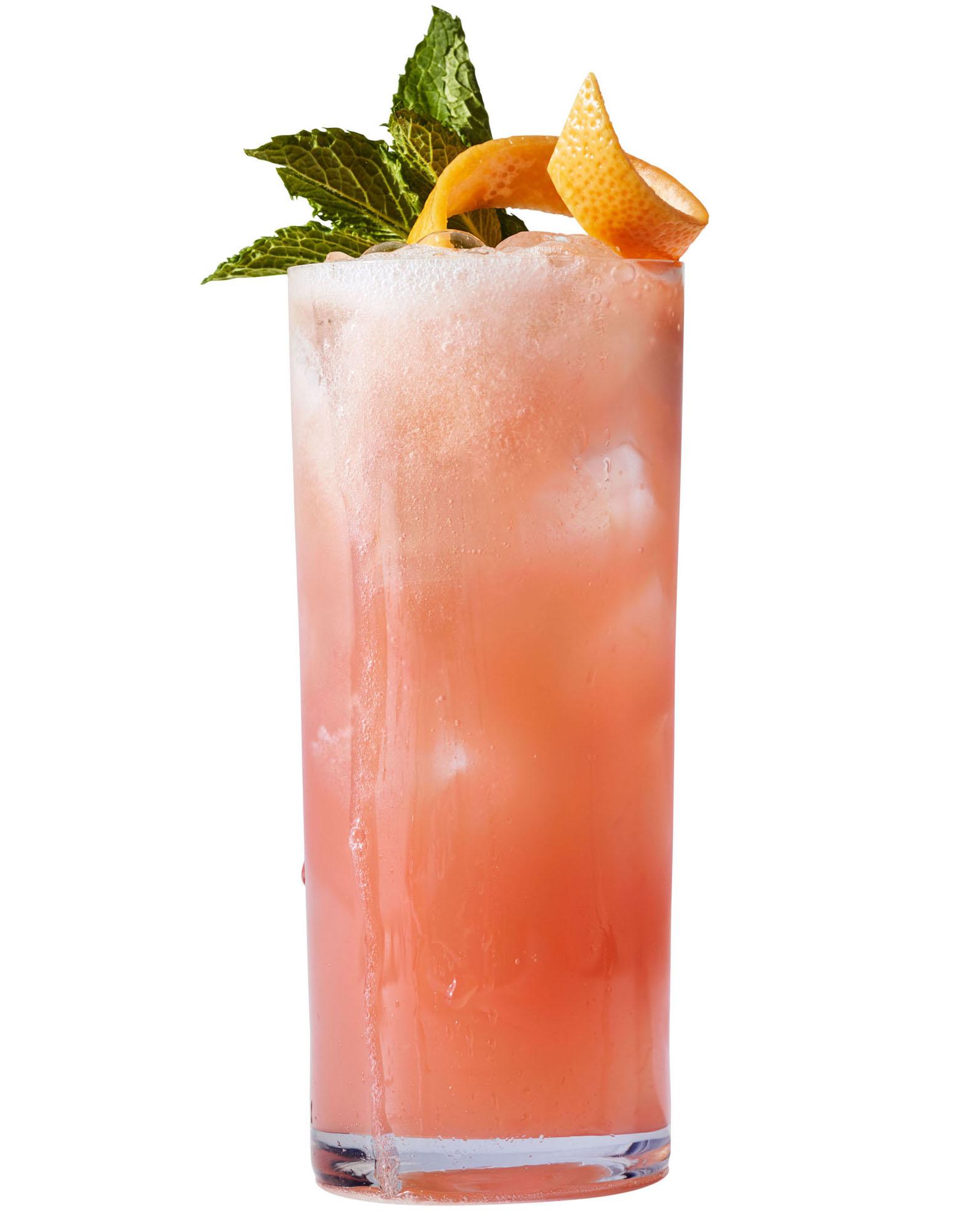pink sparkler cocktail garnished with mint sprig and grapefruit twist