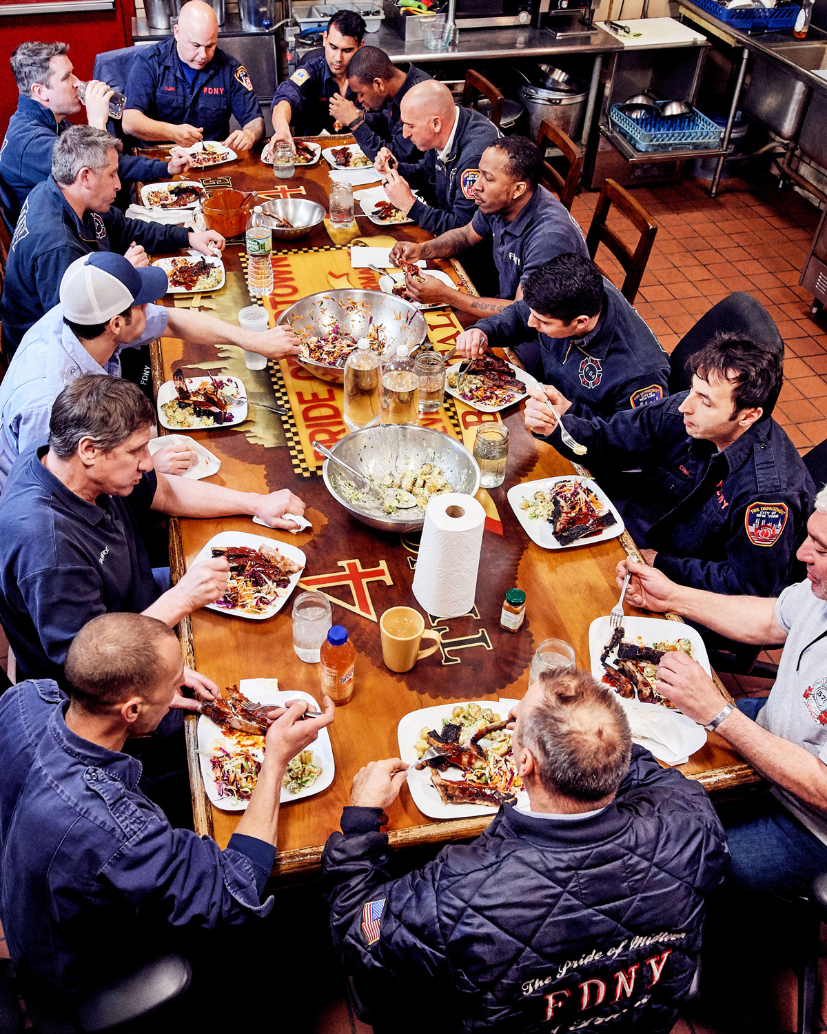 firefighters sitting around a table eating dinner