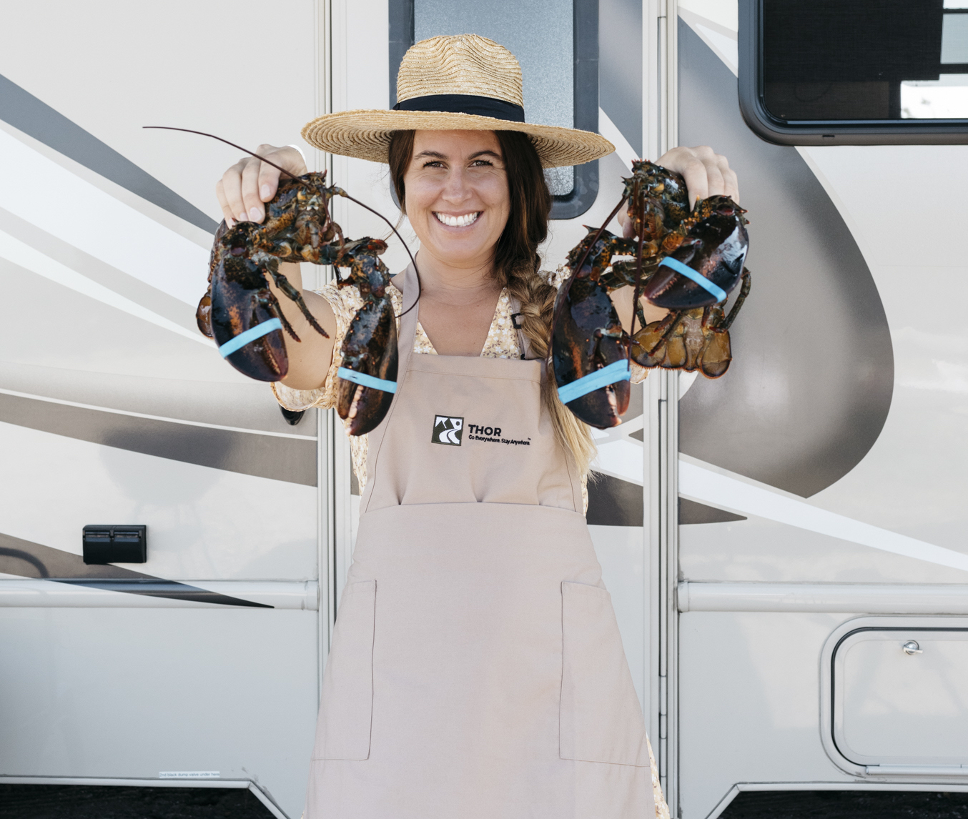 Sarah Glover in front of her THOR Motor Coach