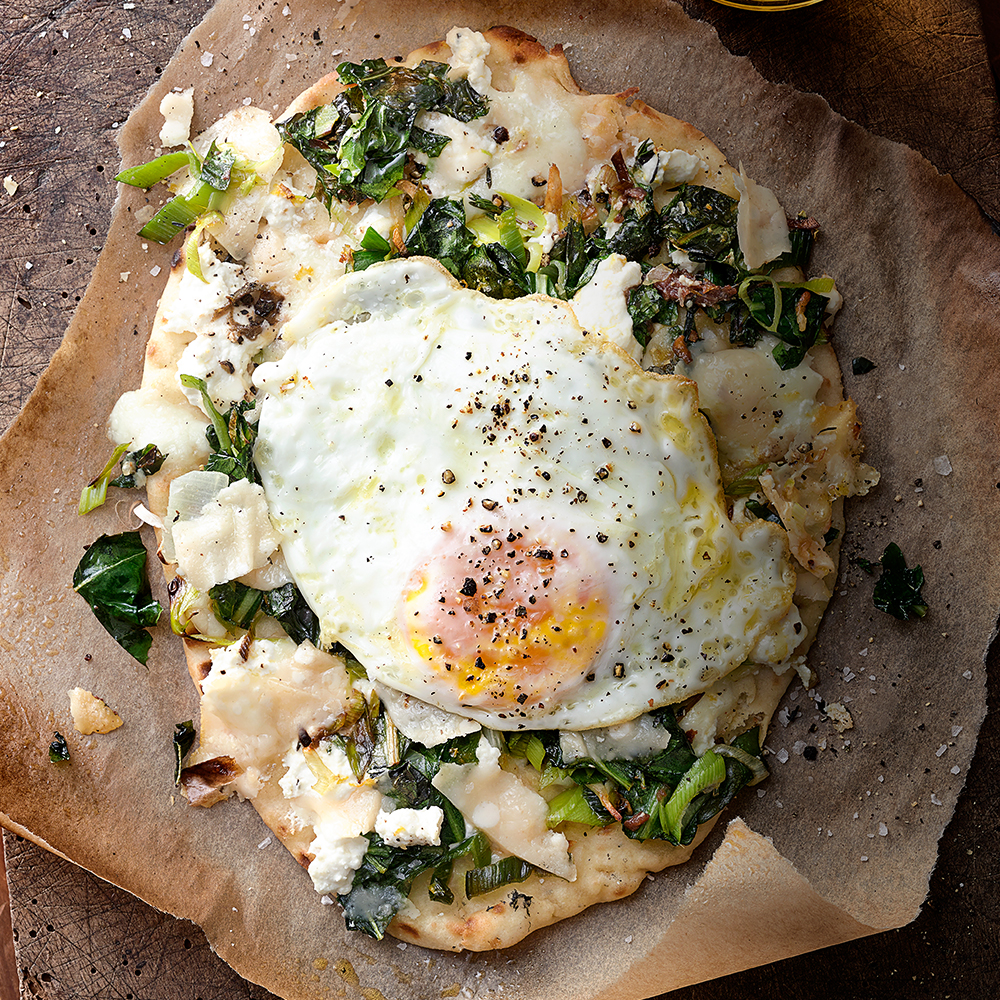 grilled flatbread pizza with greens, ricotta and eggs