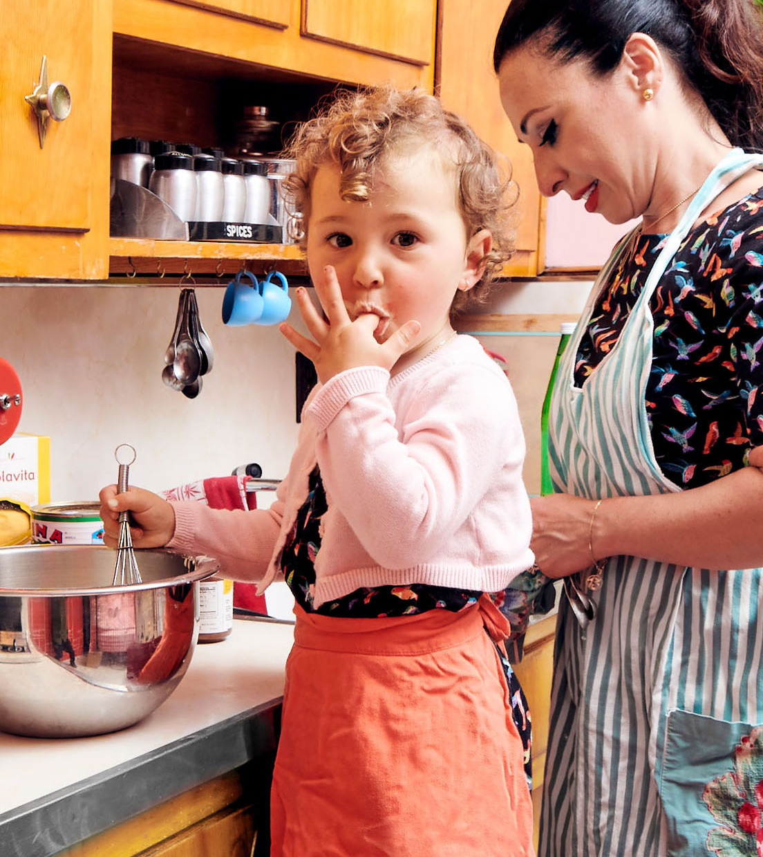 mom and daughter cook together