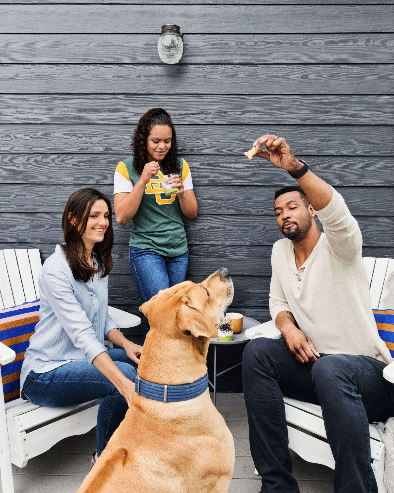 family time giving treat to dog