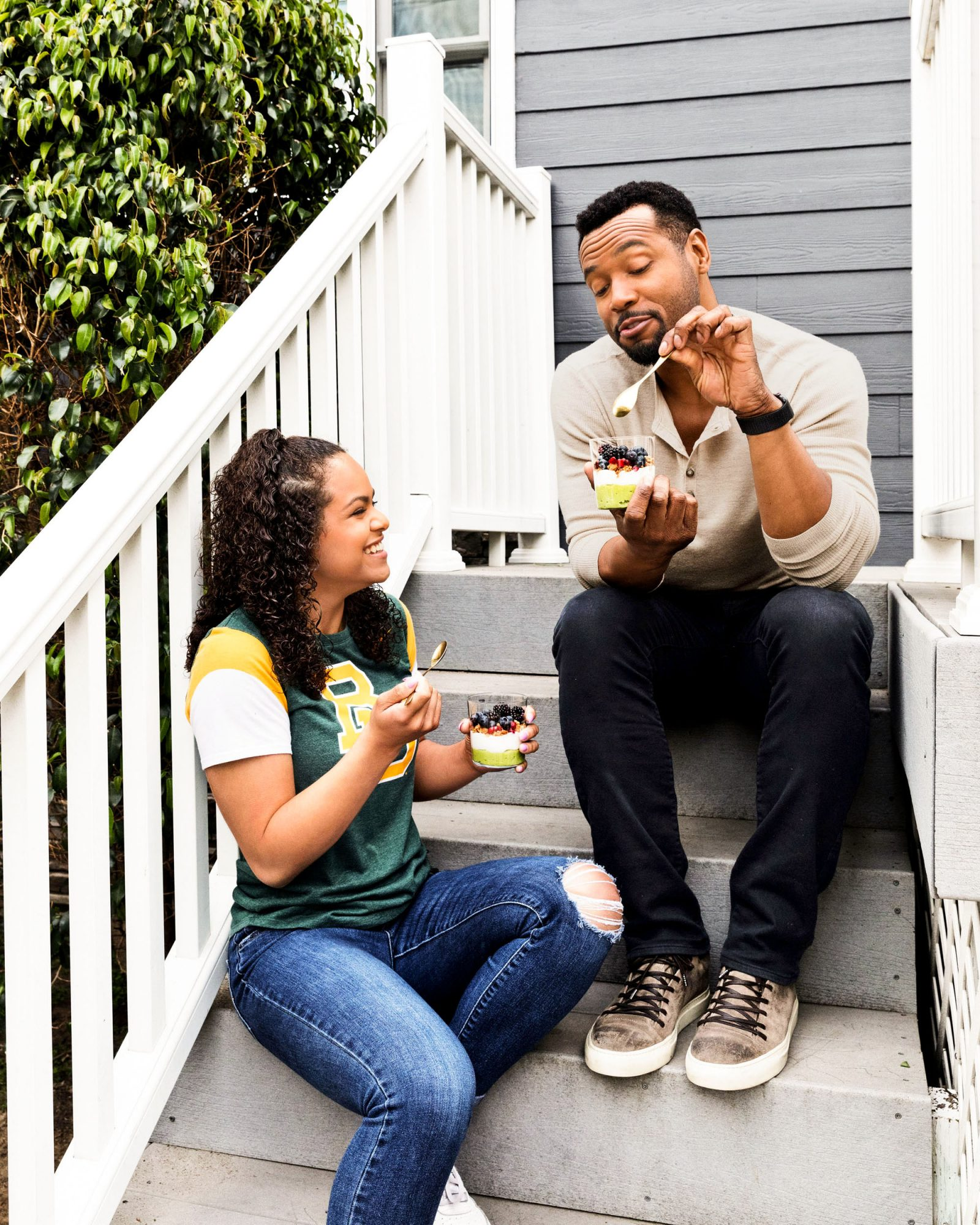 father and daughter enjoying parfaits on porch