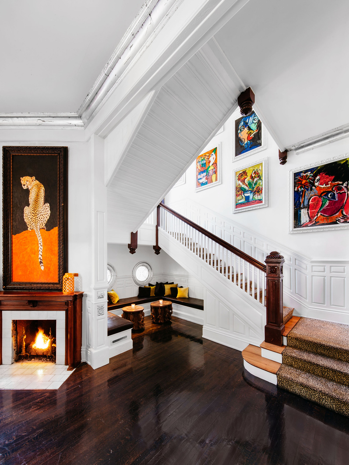 white stairway with colorful artwork at the mansion on forsyth park