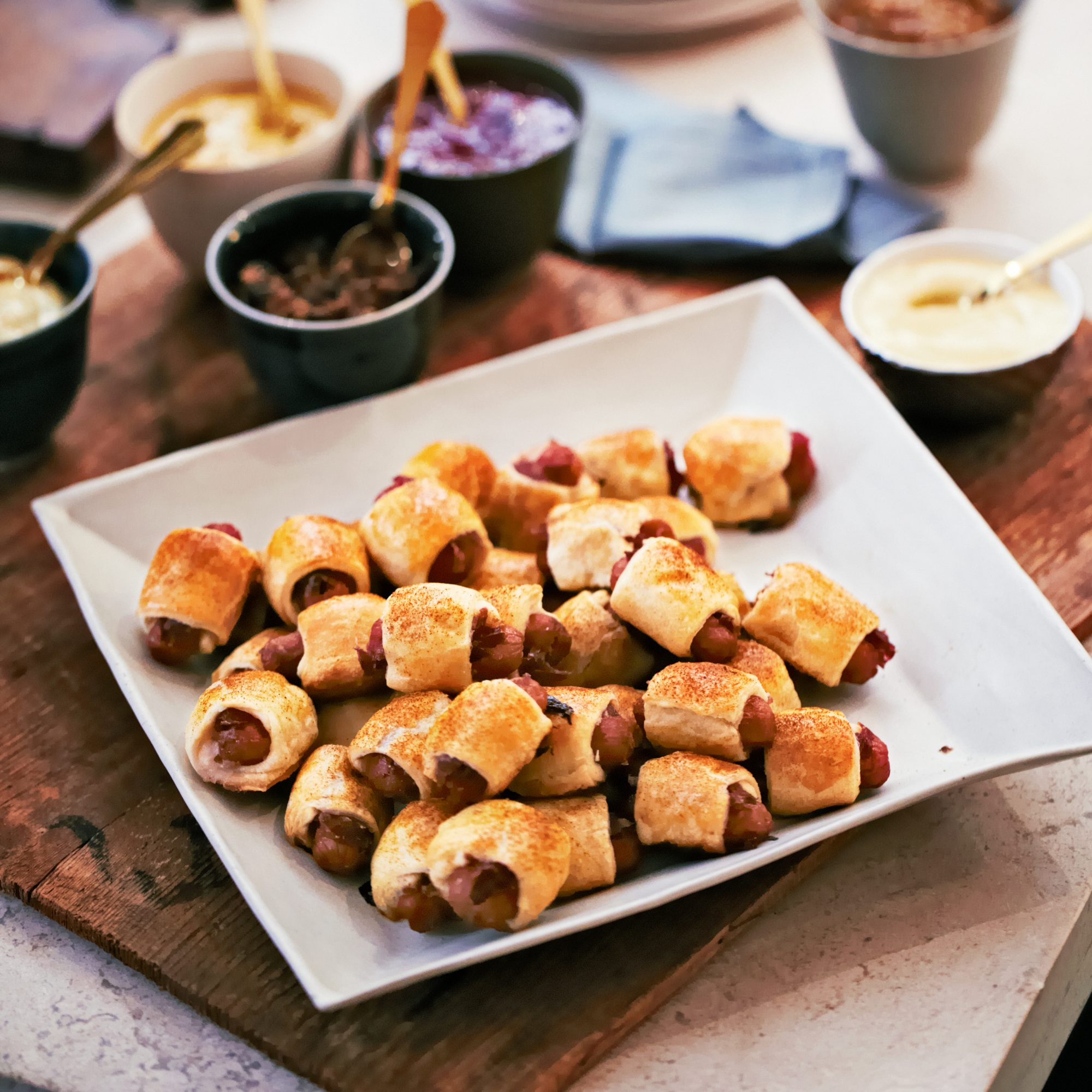 Stuffed Pigs in Blankets with Flavored Mustards