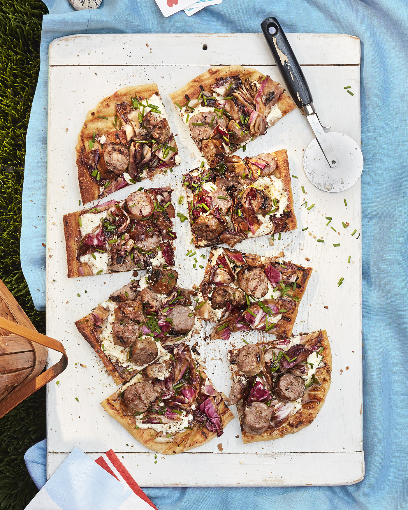 grilled sausage and radicchio pizza