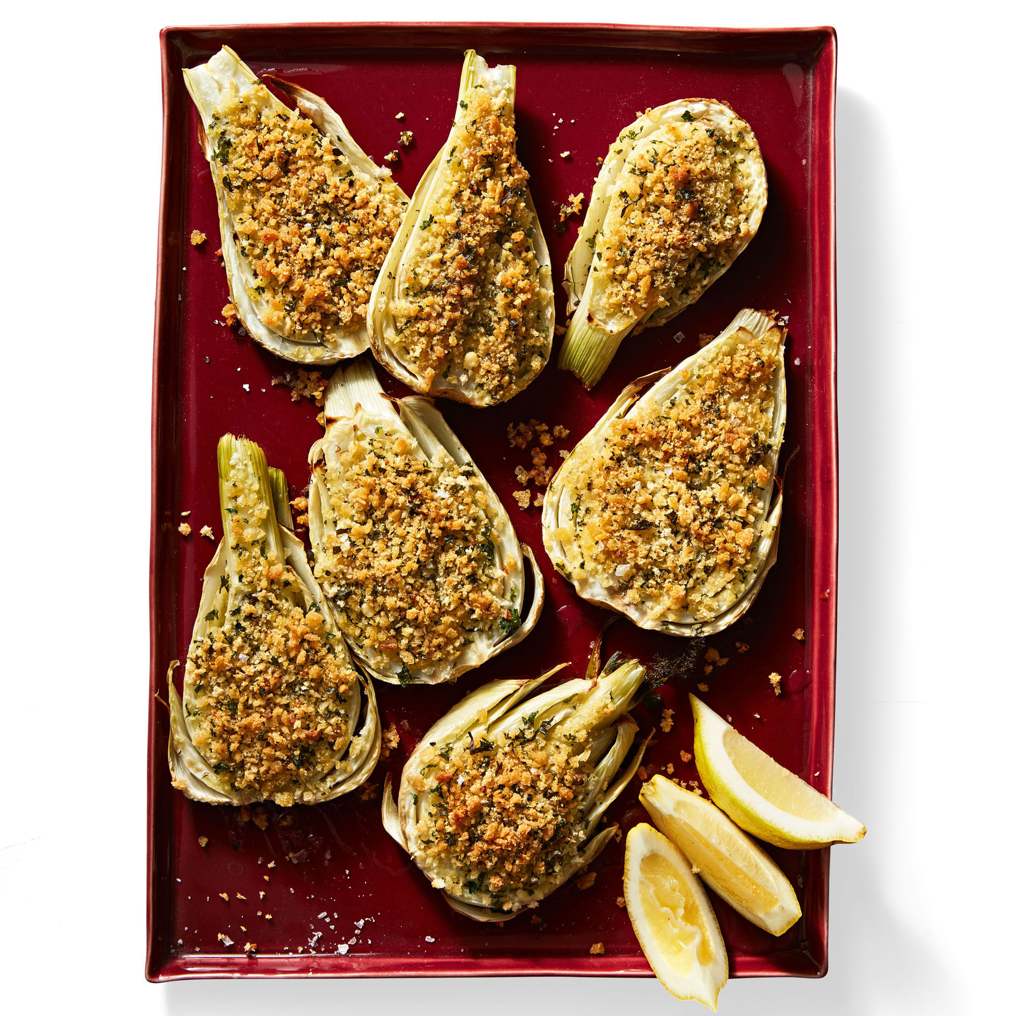 crispy roasted fennel topped with breadcrumbs and served with lemon wedges