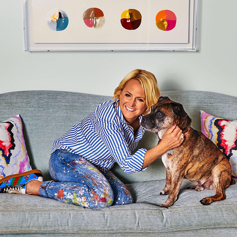 Kristi Kohut on couch with bulldog