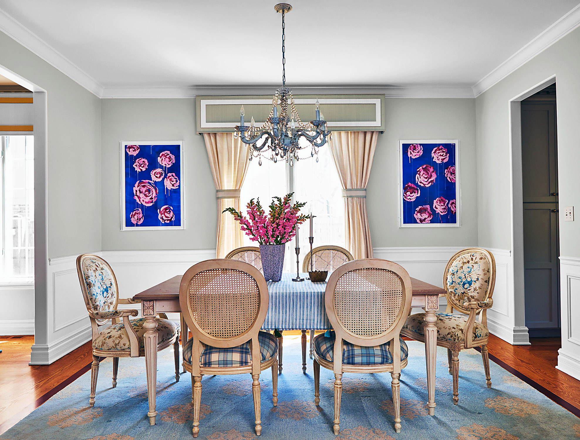 Kristi Kohuts dining room with floral canvases