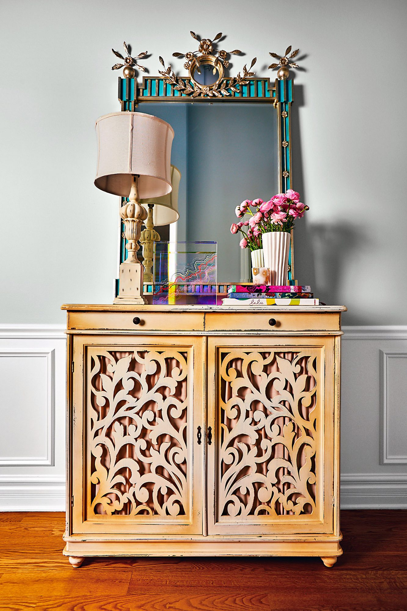 entryway with carved cabinet and mirror