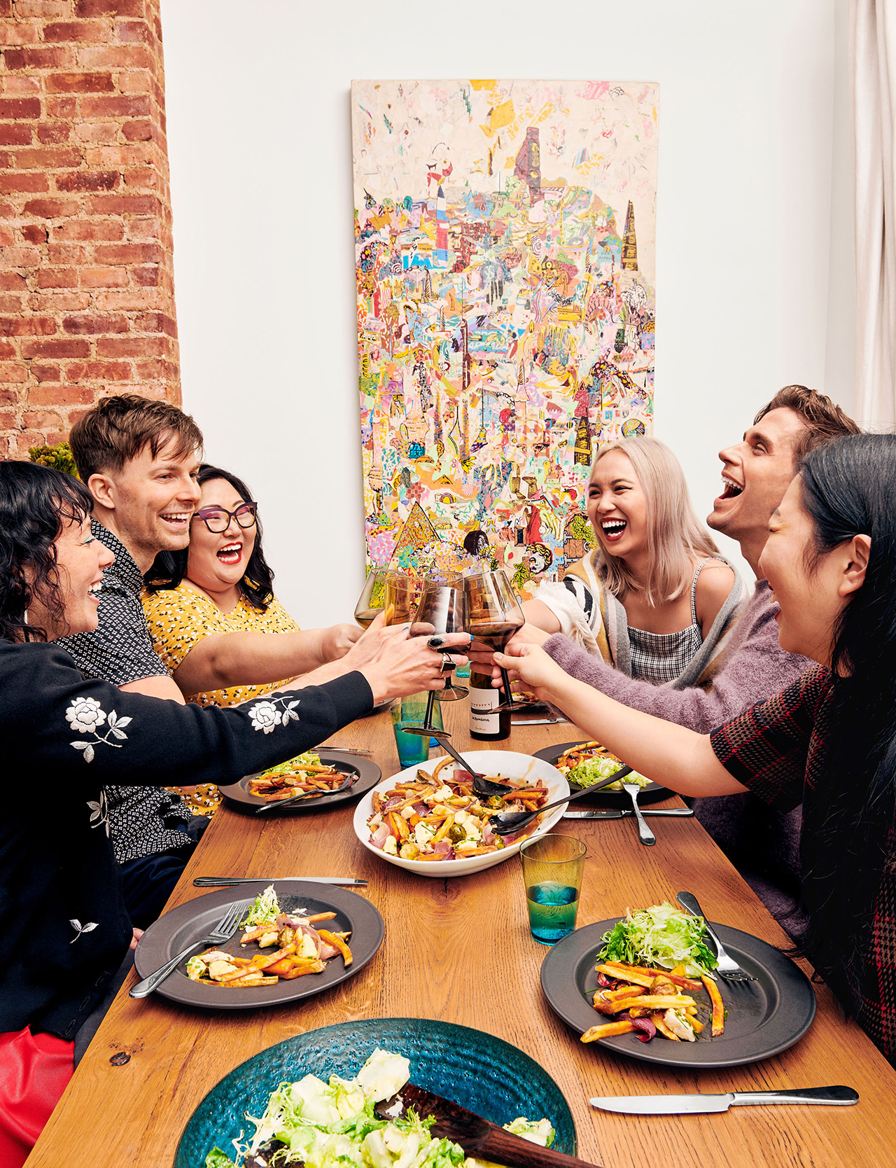 antoni and friends toasting over dinner