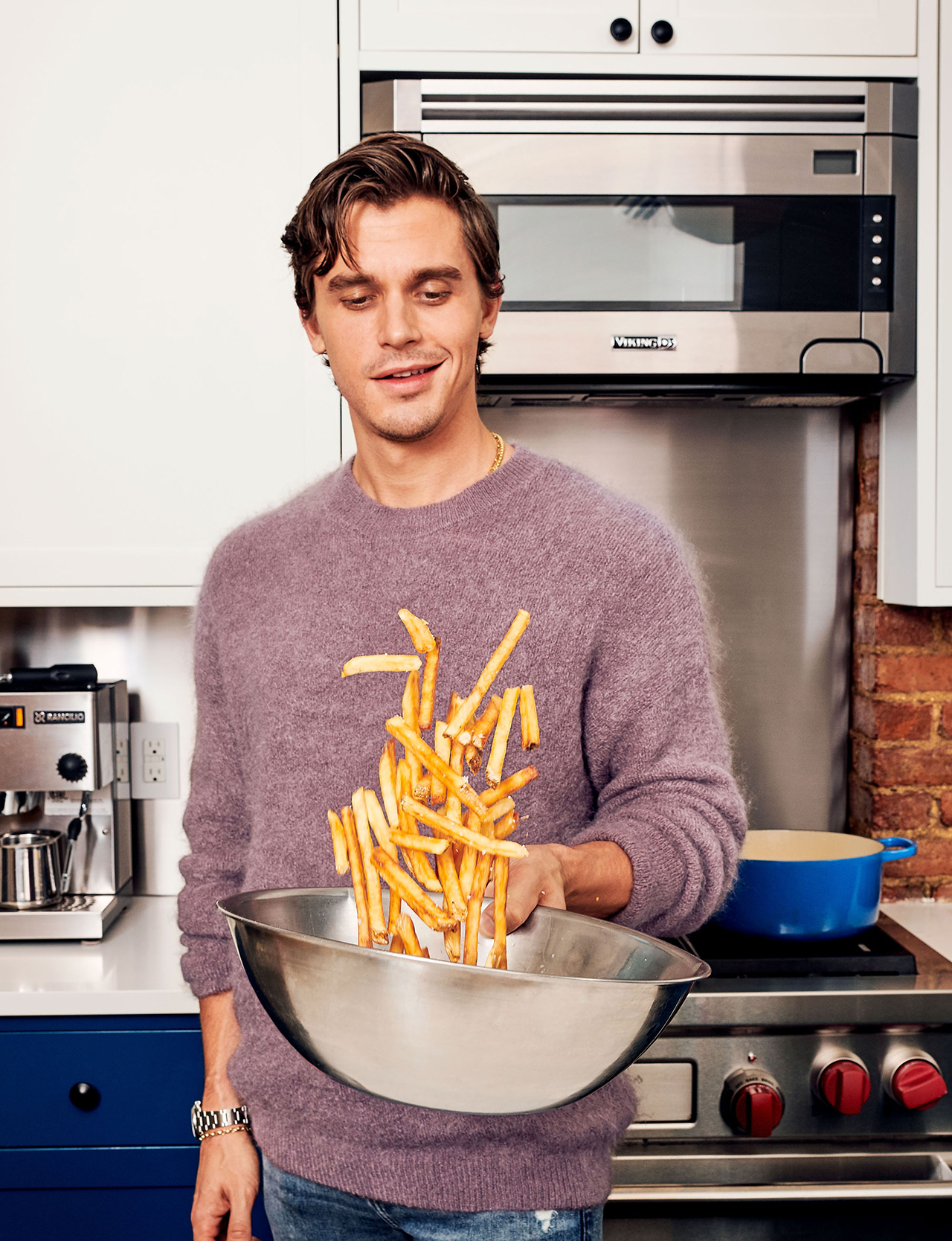 antoni tossing fries in bowl