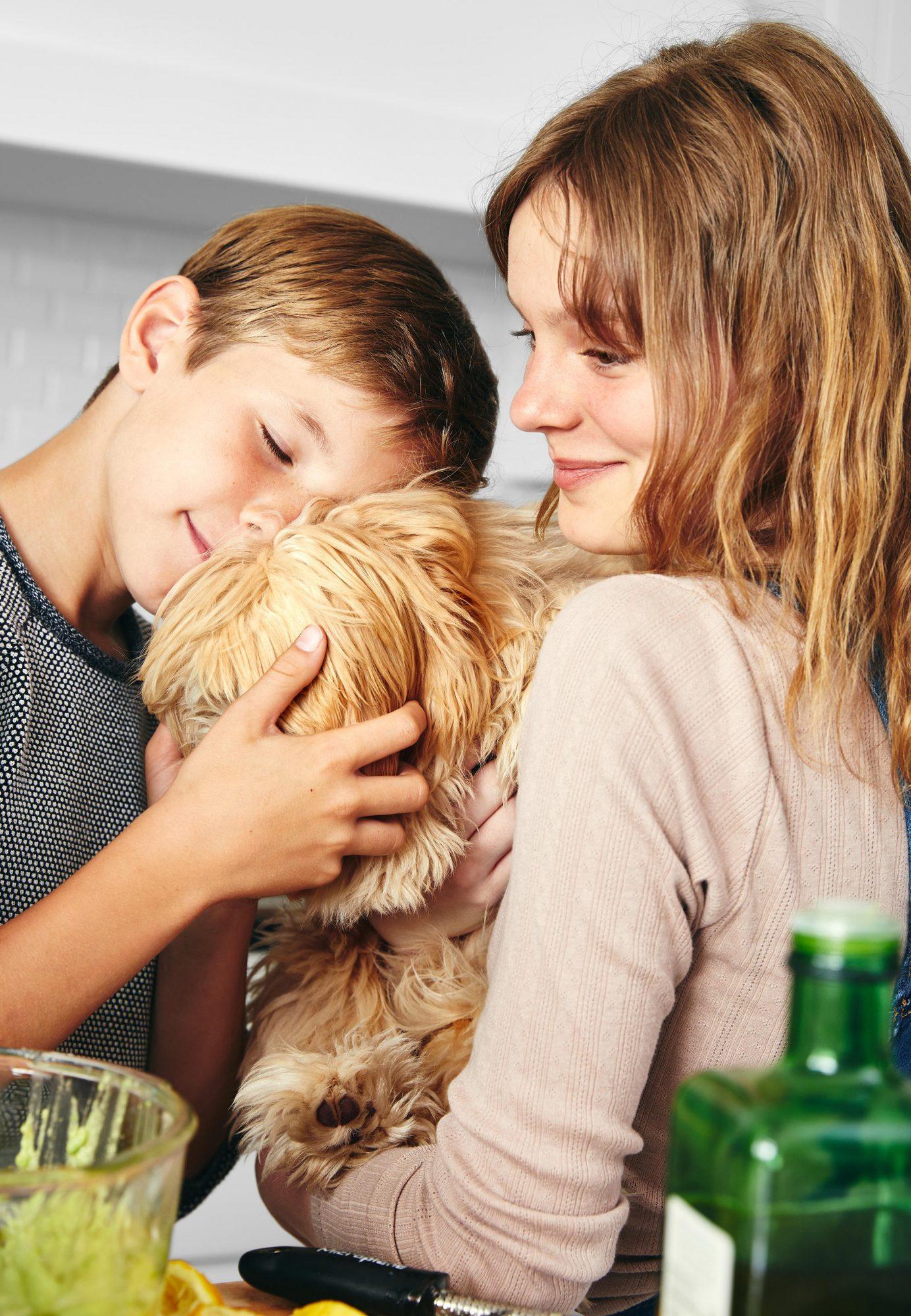 kids holding dog