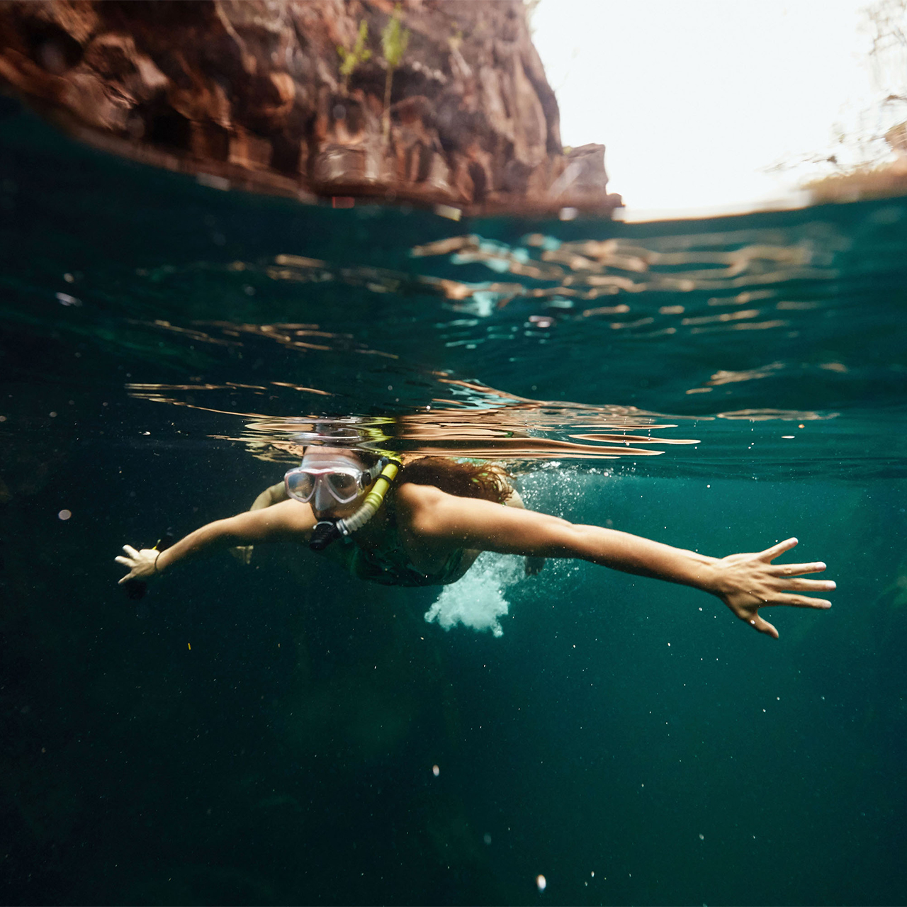 person swimming underwater in Galapagos Island