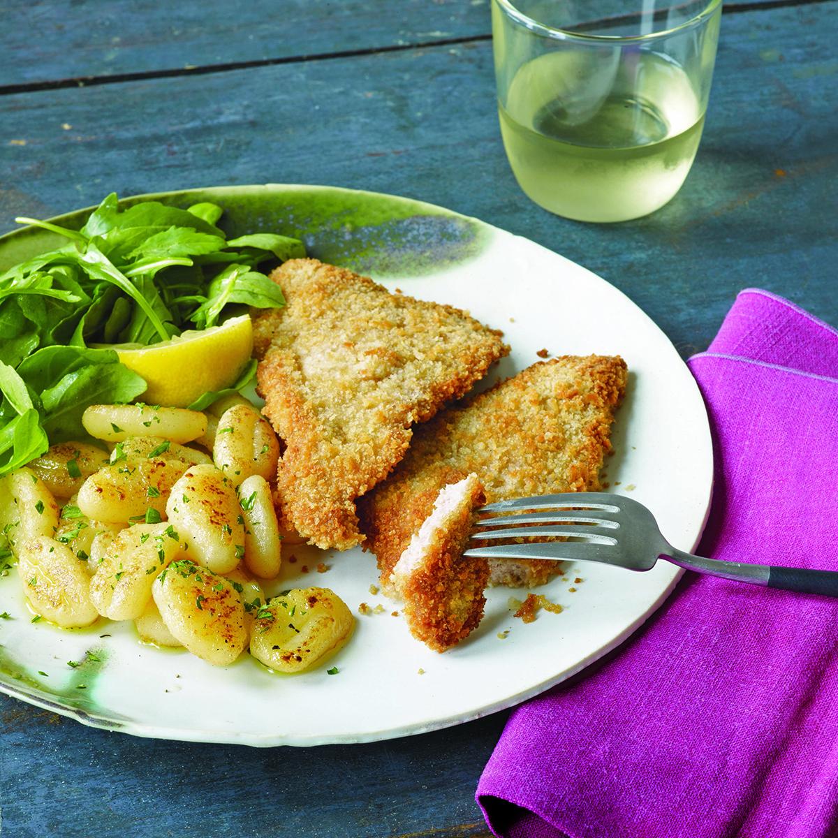 veal or pork cutlets brown butter gnocchi and dark greens