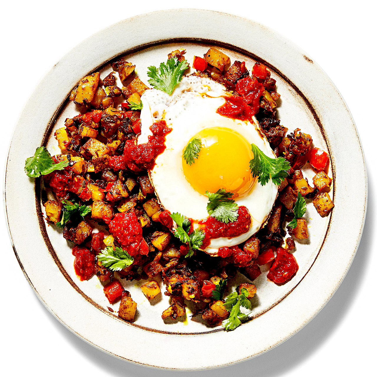 Spiced Hash & Eggs with Harissa Drizzle