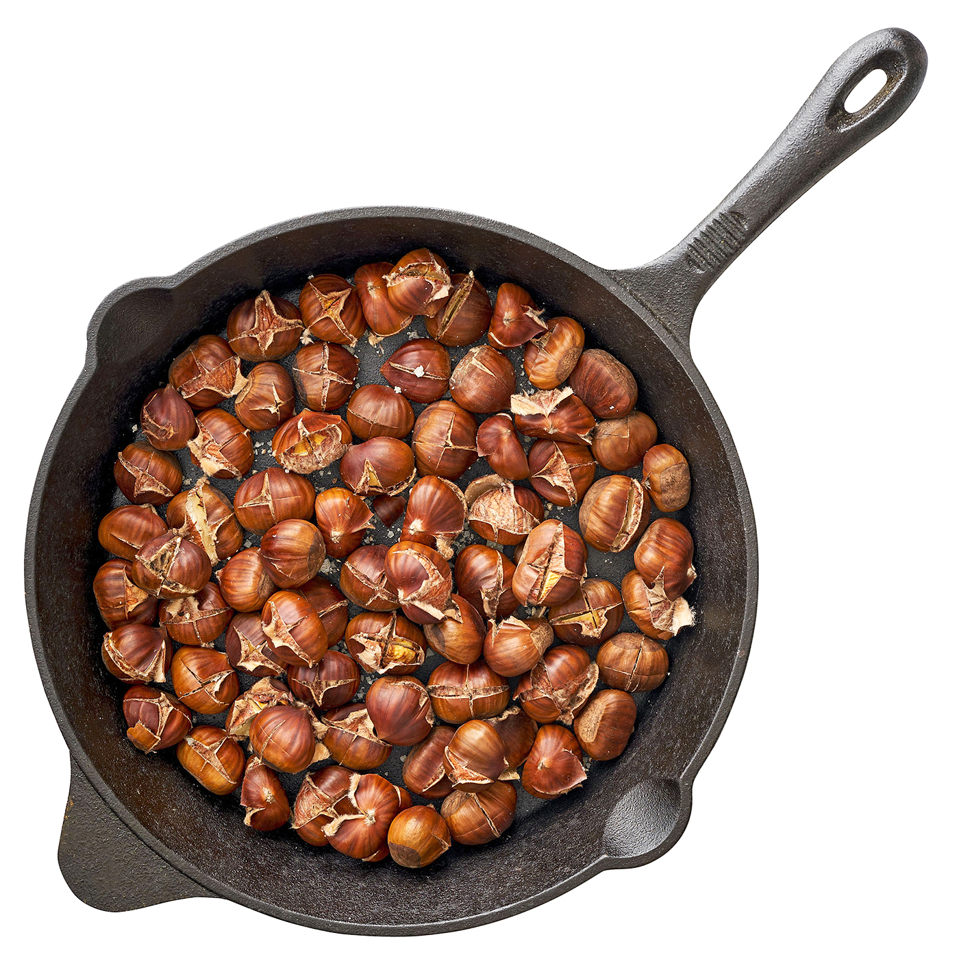 chestnuts roasting in cast-iron pan