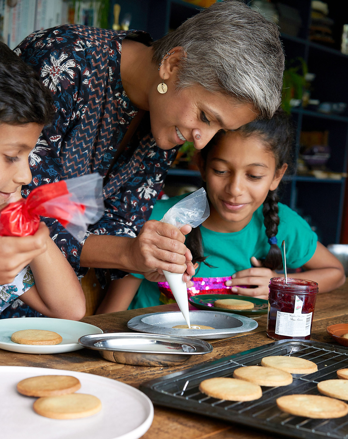 Chetna decorating cookies with kids