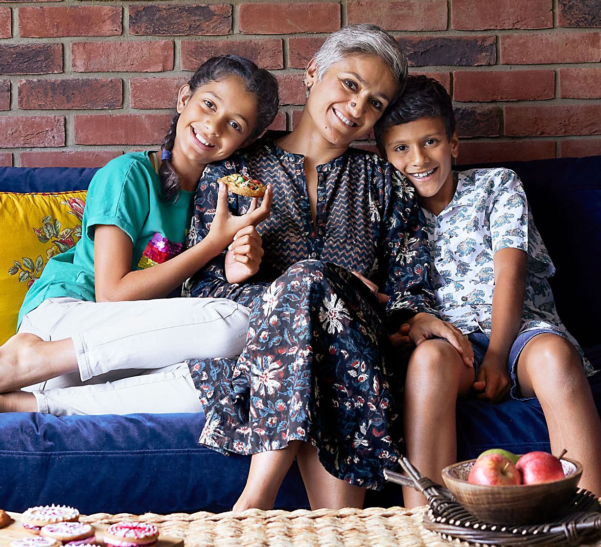 portrait of Chetna with kids on couch