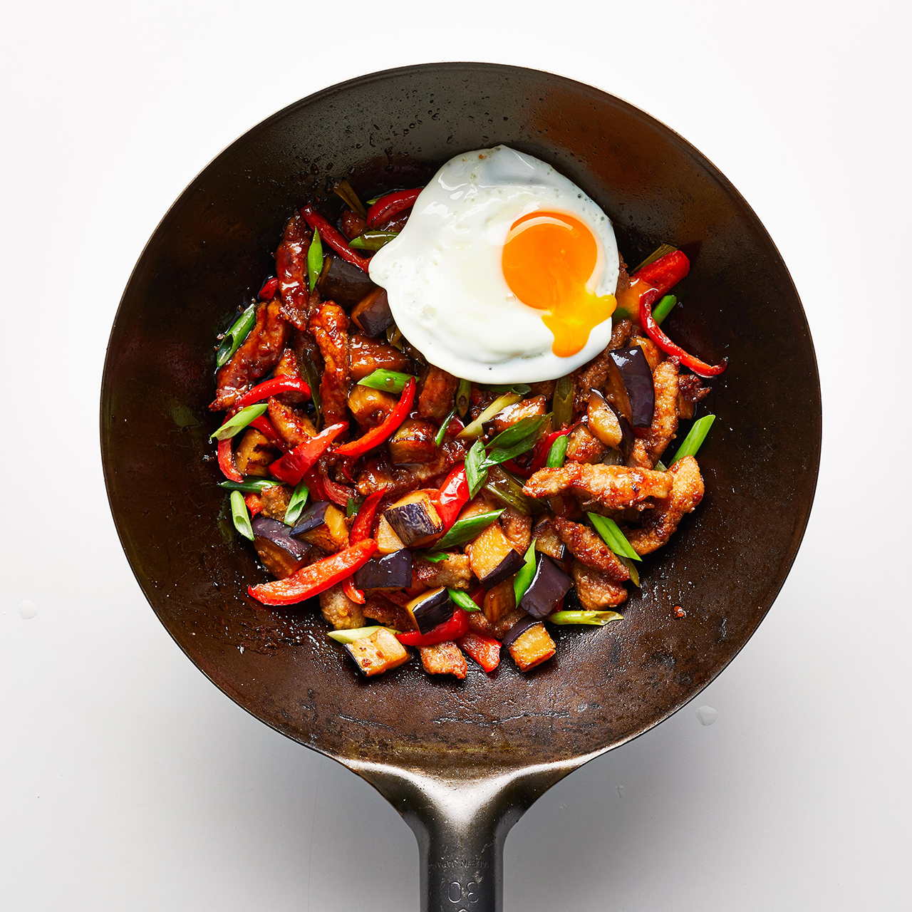 Skillet with stir fry and runny egg