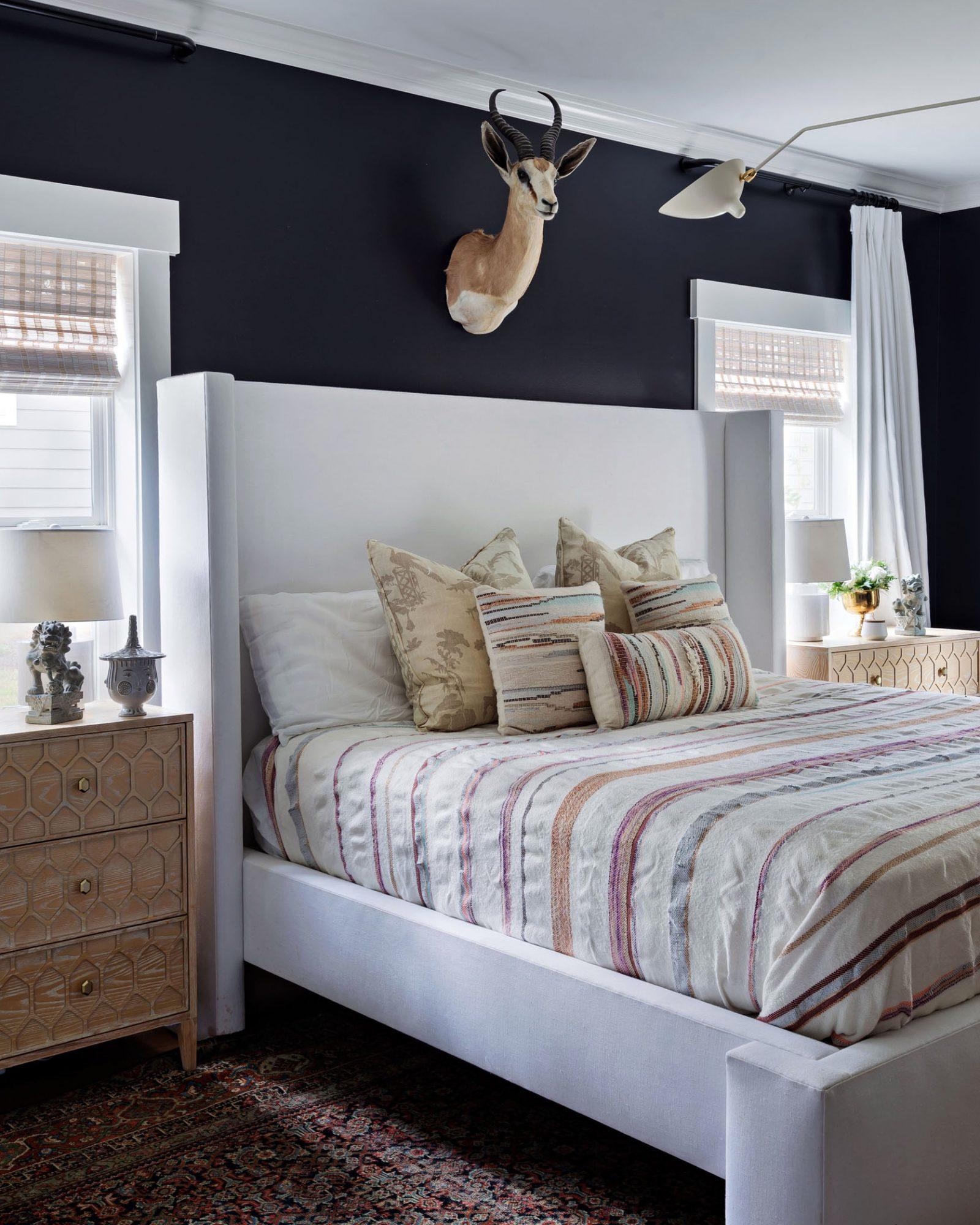 dark master bedroom with bright bedding
