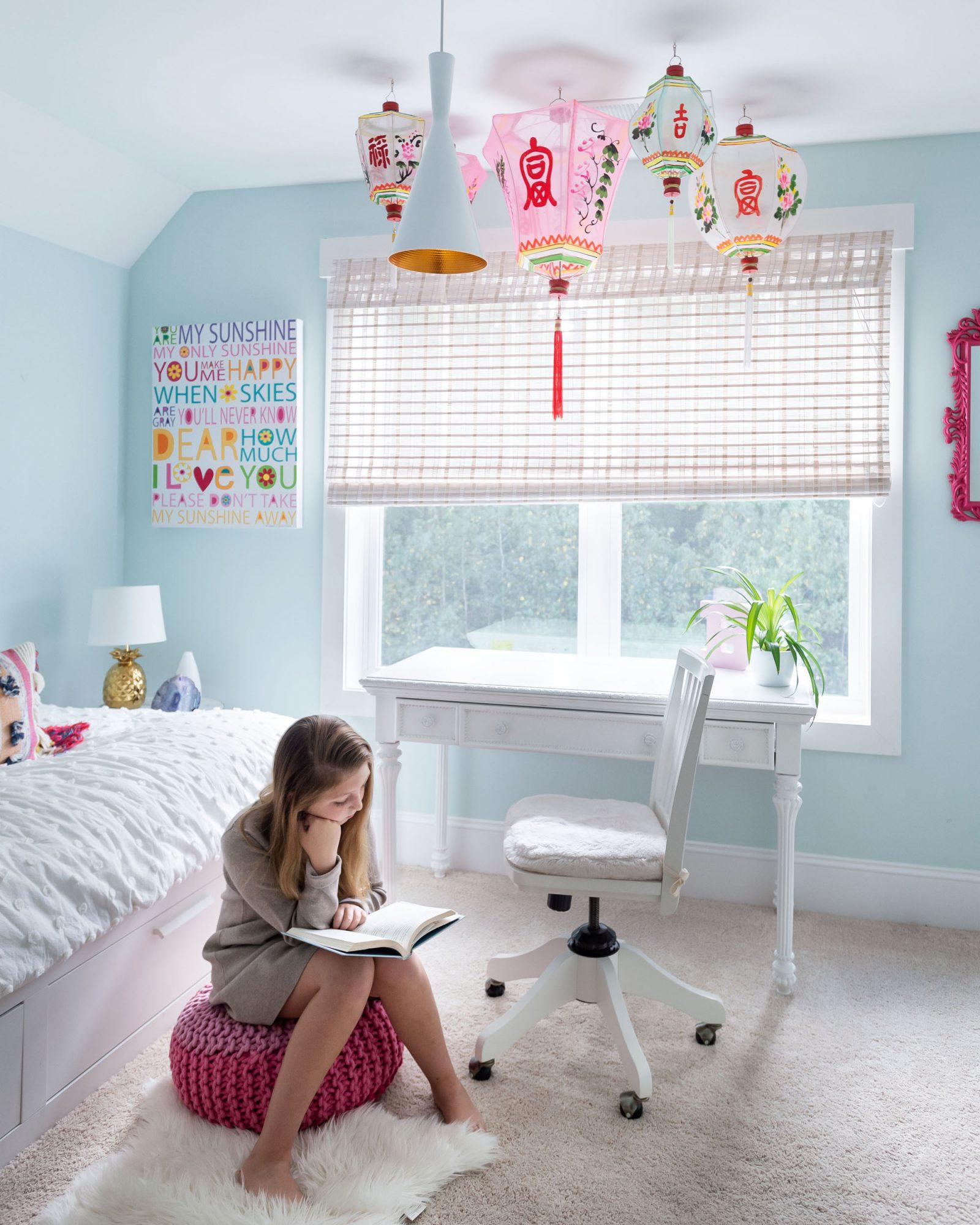 girl sitting in bedroom reading