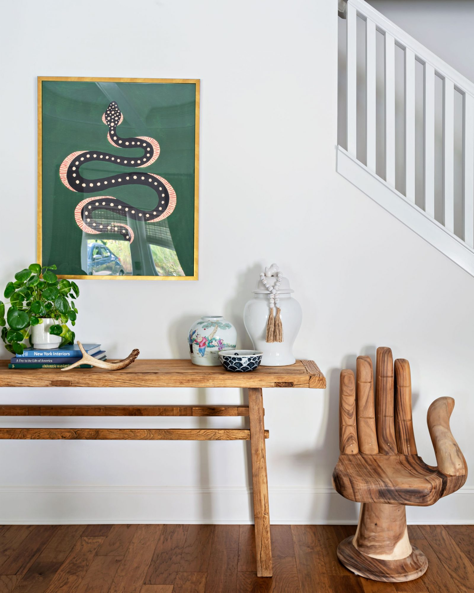 wooden table and hand chair in entryway