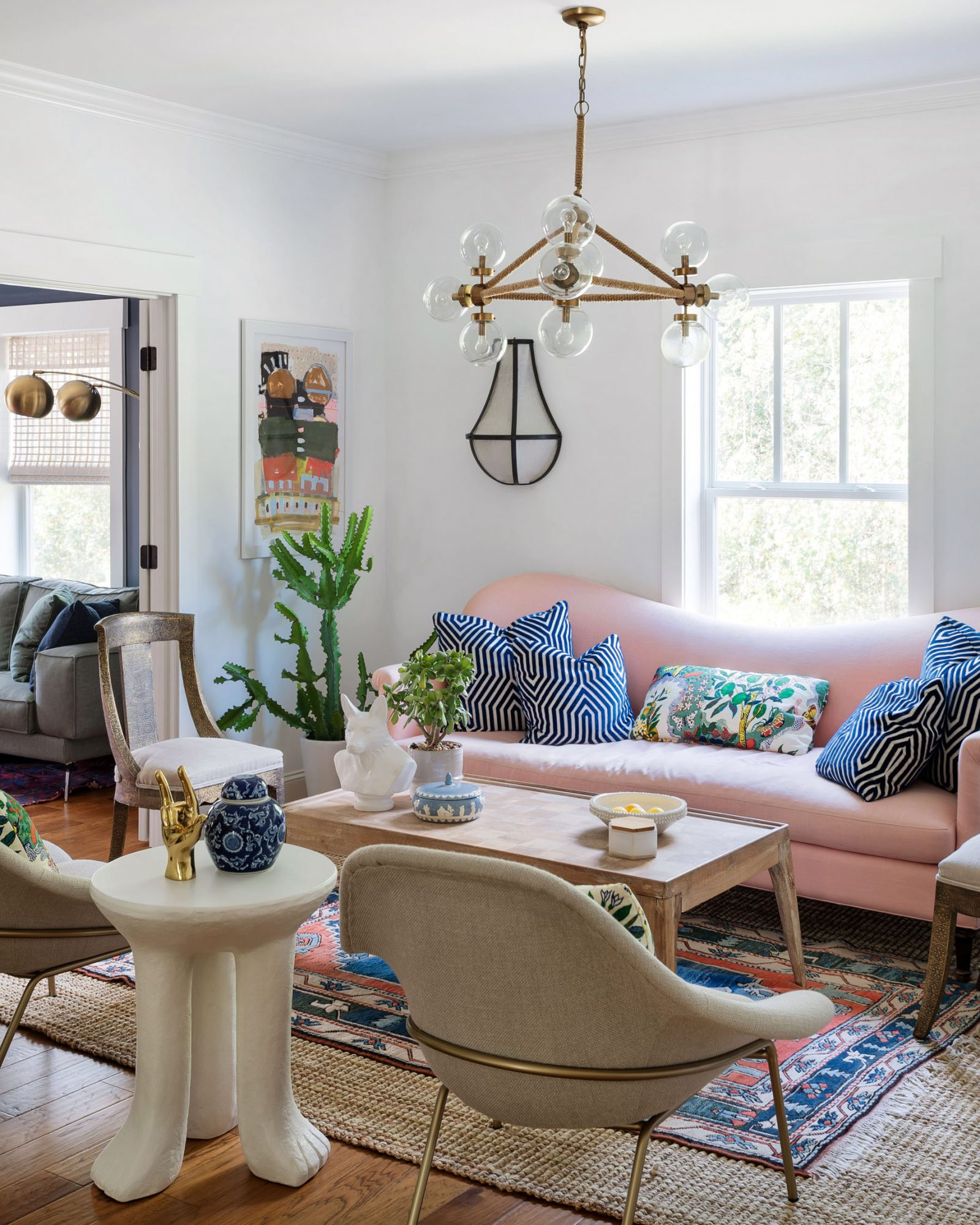 eclectic sitting room with pink couch