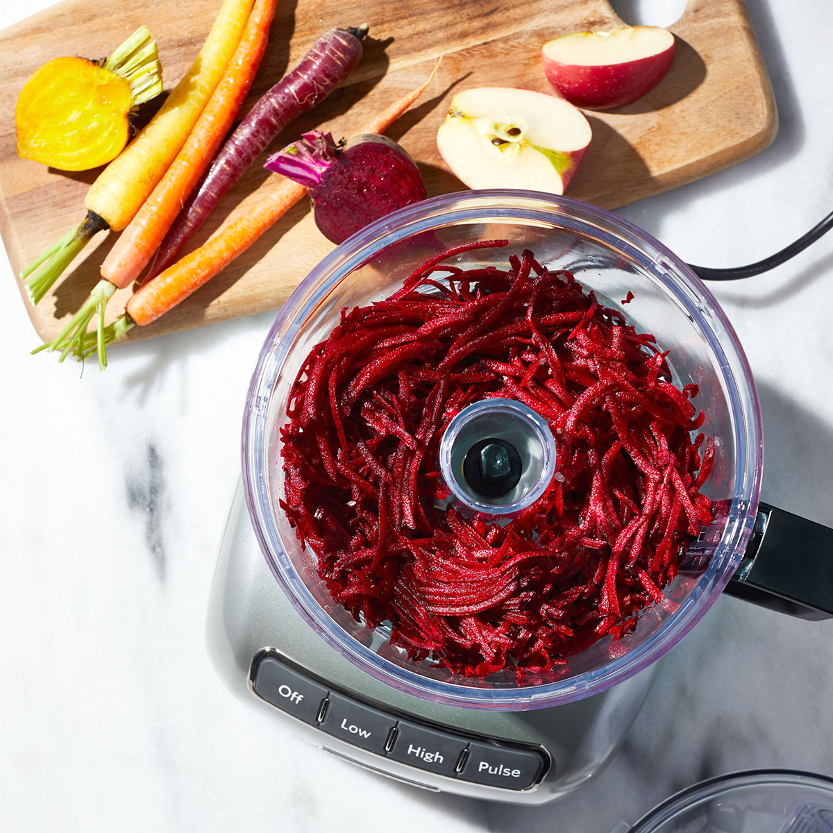 beets in food processor near cutting board