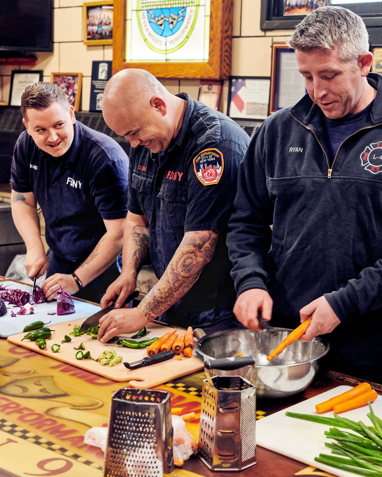 firefighters cutting and peeling vegetables
